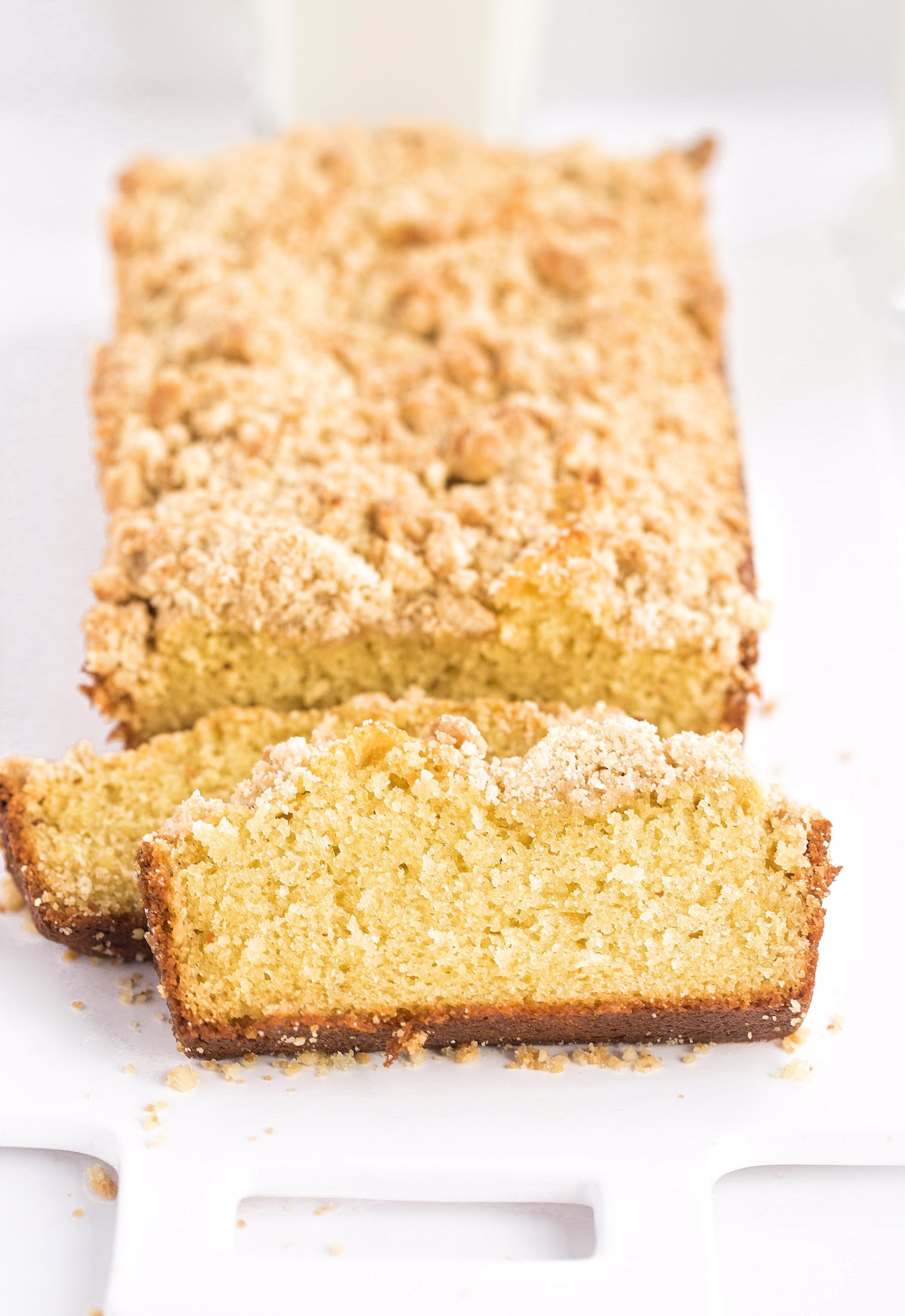 ]Fluffy Butter Streusel Loaf Cake: this loaf cake is rich and flavorful like a butter cake yet fluffy like a yellow cake. Topped generously with a tasty streusel! | TrufflesandTrends.com