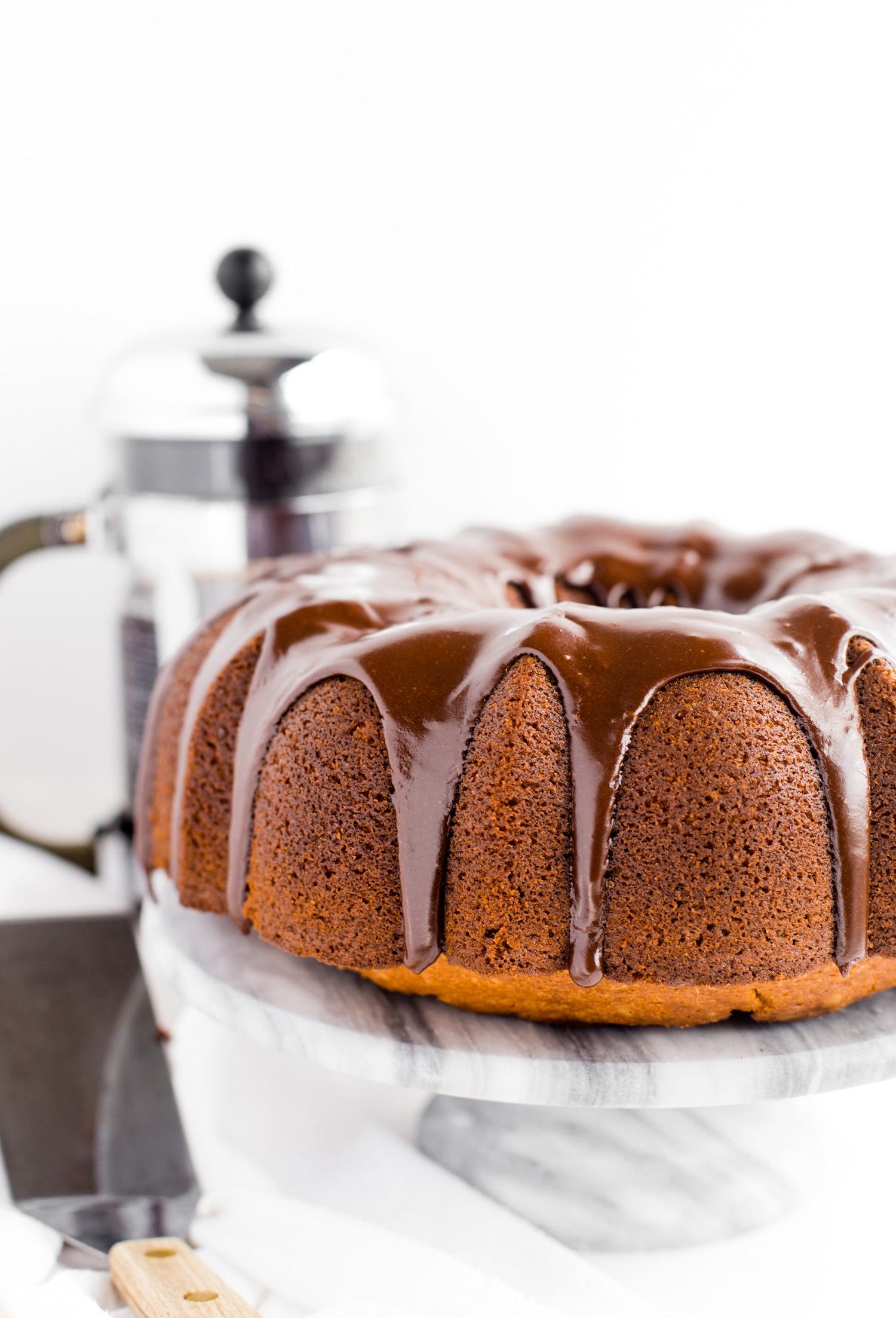 Vanilla Bundt Cake with Gooey Chocolate Center: soft, tender, fluffy yet hefty vanilla cake with a gooey, rich, oozing chocolate center. Dairy-free!   TrufflesandTrends.com