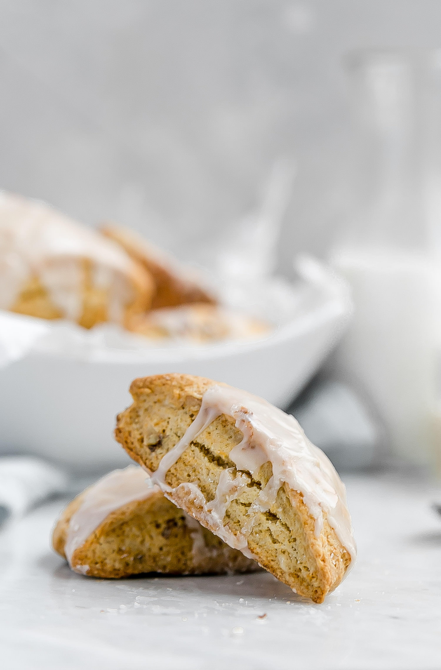 Early Grey Toasted Walnut Honey Scones: tender scones sweetened with honey, speckled with toasted walnuts, and topped with an earl grey glaze. | TrufflesandTrends.com