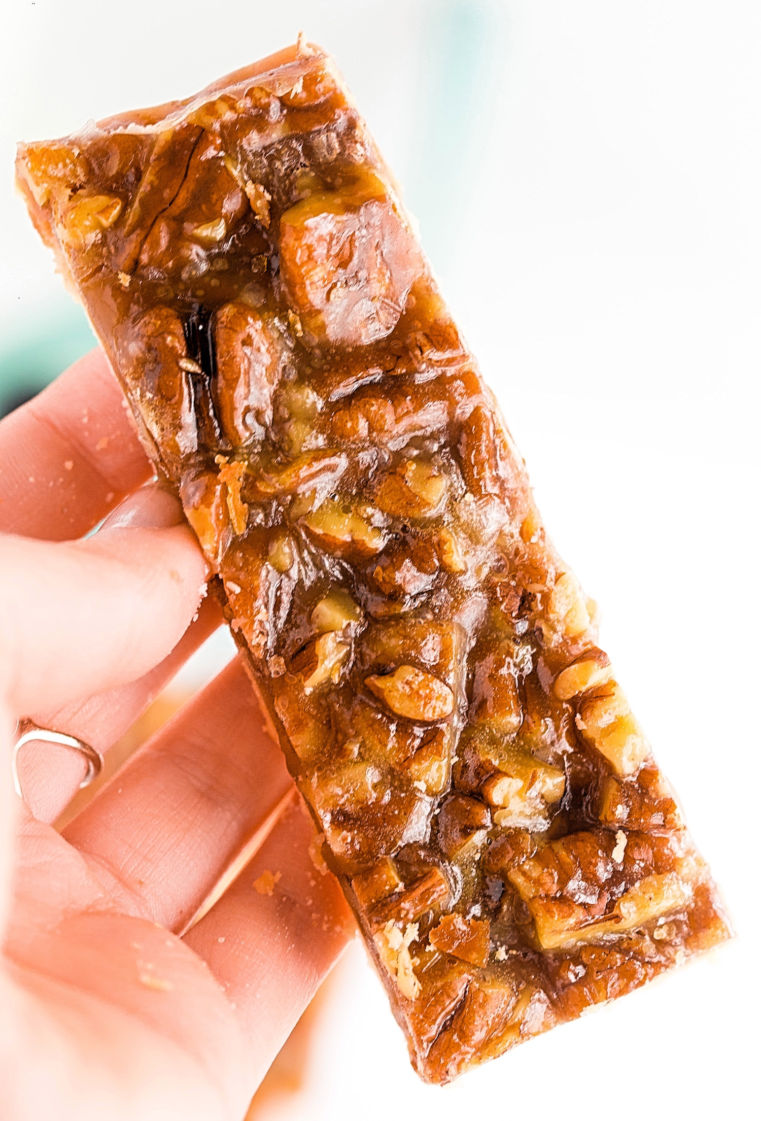 Pecan Pie Bars: flaky, buttery crust topped with a sweet, buttery pecan pie mixture, yielding crispy, crunchy, chewy, soft, buttery, caramely, sweet + salty pecan pie bars. | TrufflesandTrends.com