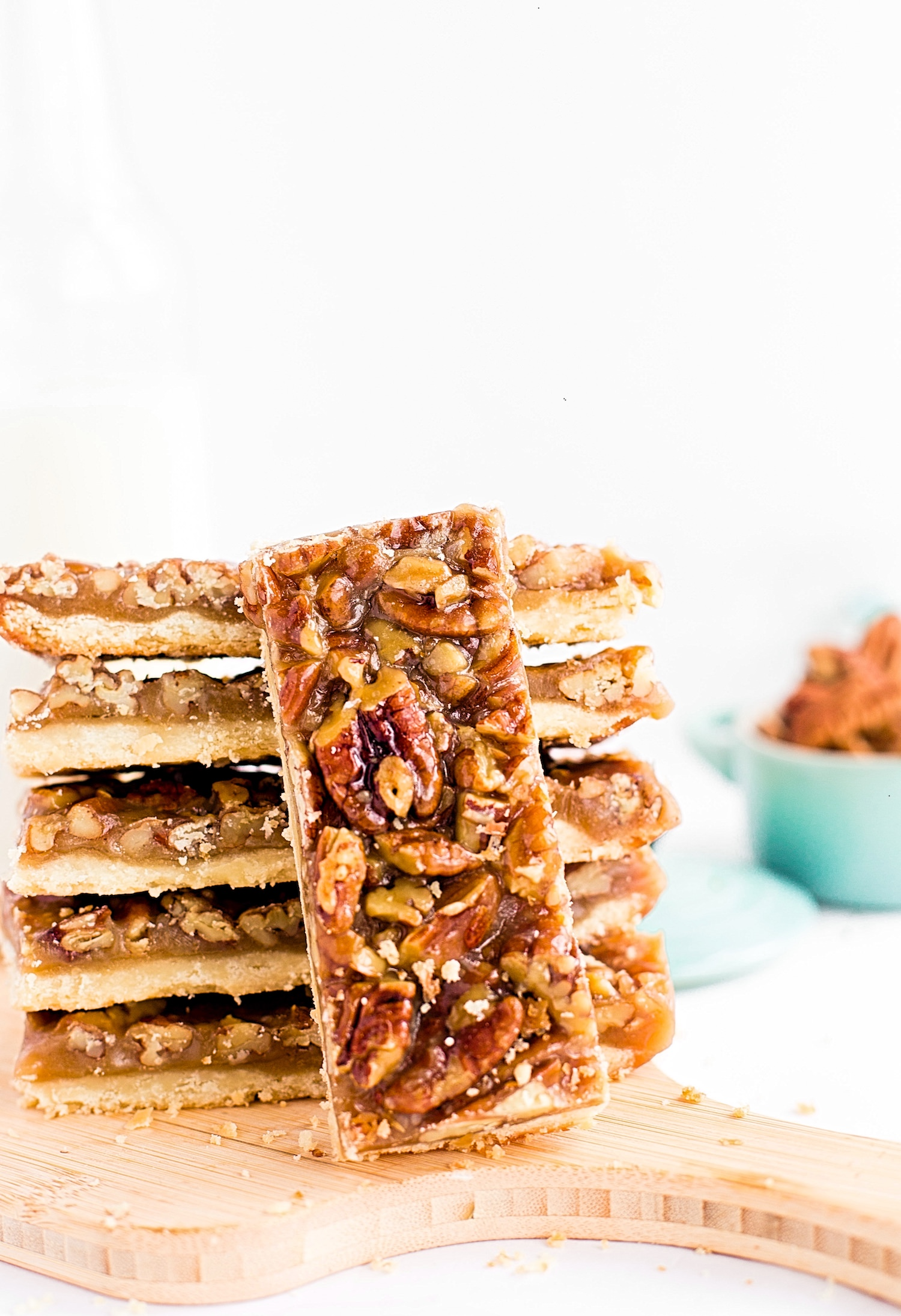 Whisk Pecan Pie Bars 3.jpgPecan Pie Bars: flaky, buttery crust topped with a sweet, buttery pecan pie mixture, yielding crispy, crunchy, chewy, soft, buttery, caramely, sweet + salty pecan pie bars. | TrufflesandTrends.com