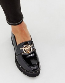 Glamorous black chunky flat shoes with gold lion trim