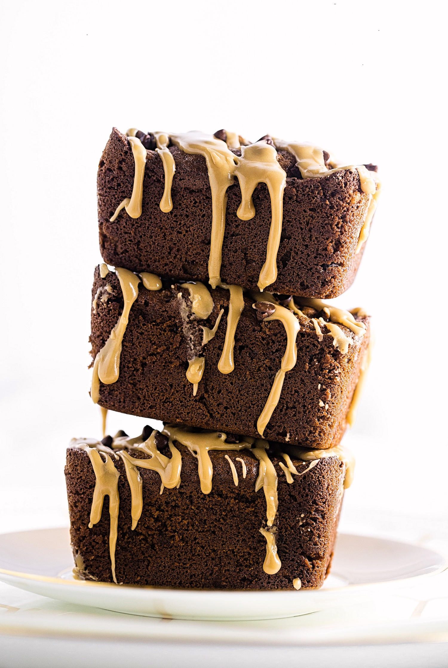 Gluten-Free Mocha Chocolate Chip Walnut Mini Loaf Cakes: soft, tender, slightly gooey, and packed with flavor from cocoa, coffee, chocolate chips, walnuts, and a glossy coffee glaze.