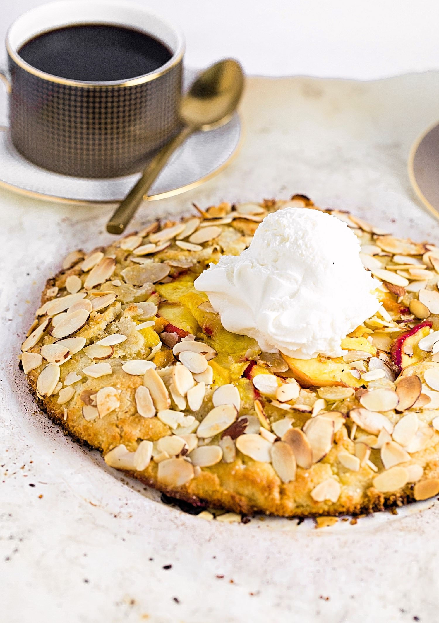 Gluten-Free Almond Peach Galette: almond flour crust (that requires no fridge chilling!) filled with a juicy peach + almond filling. So easy and beautiful! | TrufflesandTrends.com