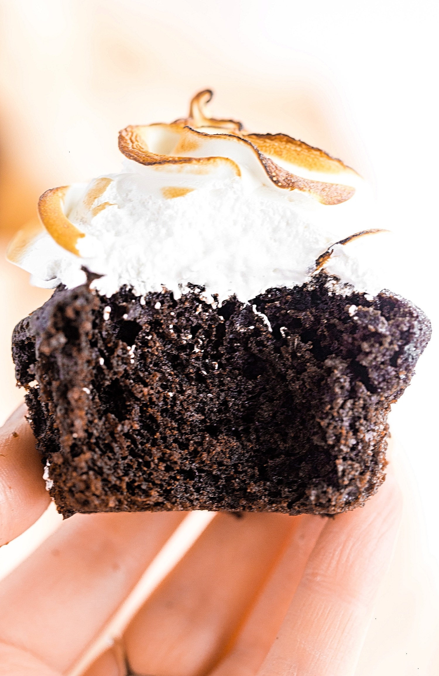 Moist Chocolate Cupcakes with Meringue Frosting: soft and moist, rich and chocolaty, and fluffy and tender chocolate cupcakes with meringue topping. | TrufflesandTrends.com