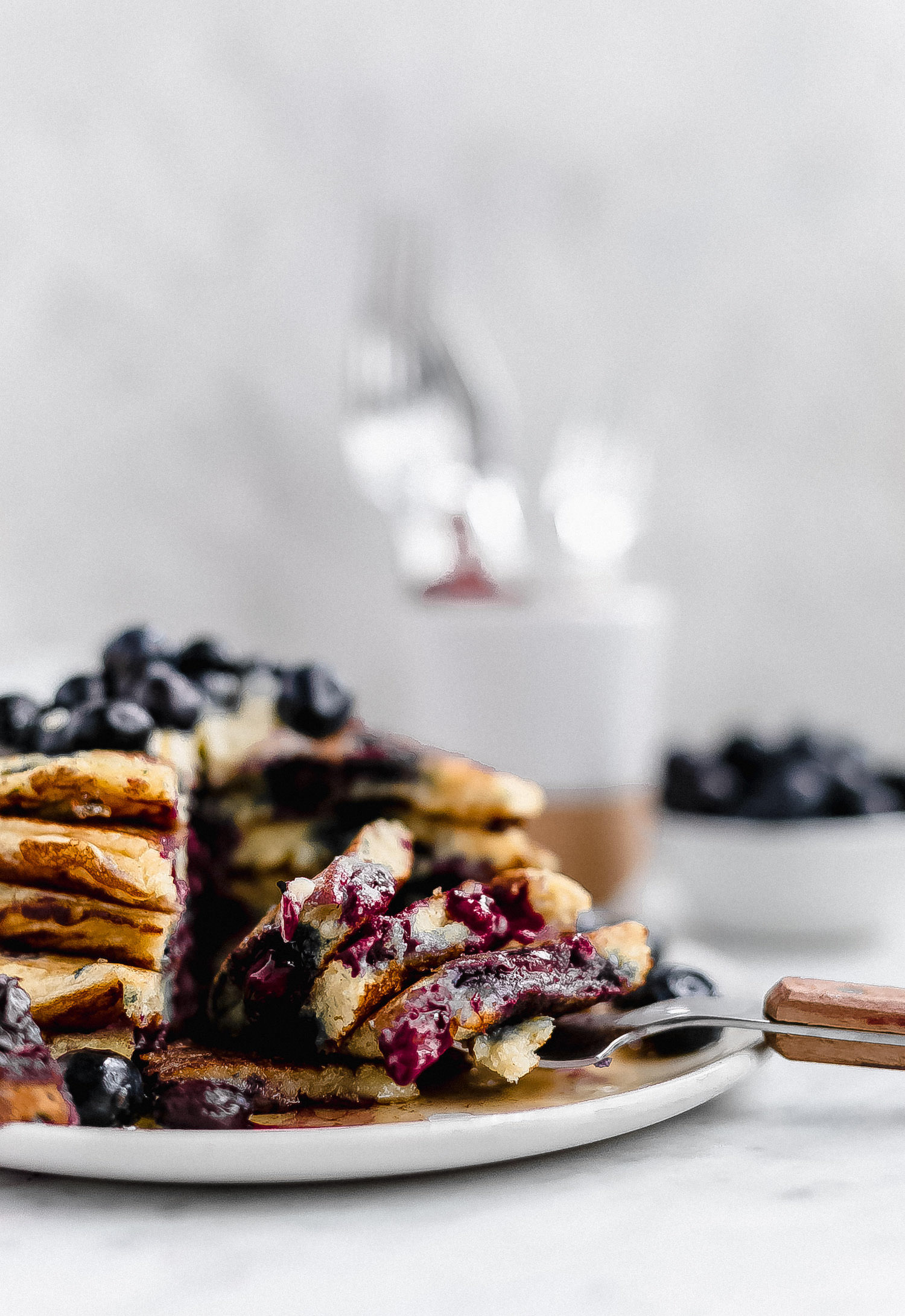 Favorite Blueberry Pancakes: soft, fluffy, rich, flavorful pancakes bursting with fresh, tart blueberries. Favorite pancake recipe ever! | TrufflesandTrends.com