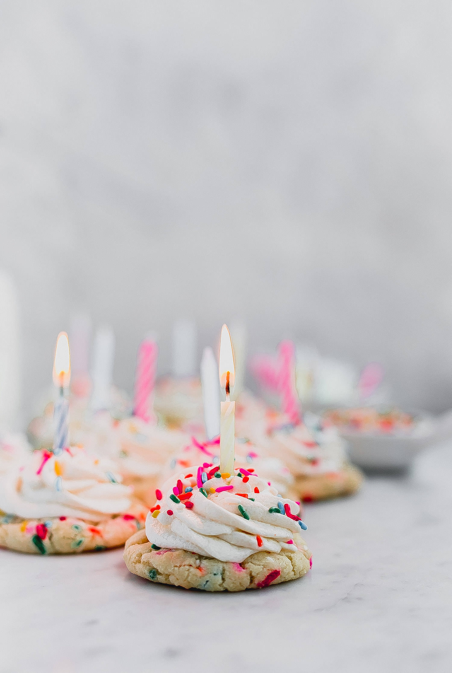 Funfetti Birthday Cookies: sot, chewy, rich, buttery sprinkle cookies topped with cream cheese frosting. Add a candle and you've got the ultimate birthday cookie! |TrufflesandTrends.com