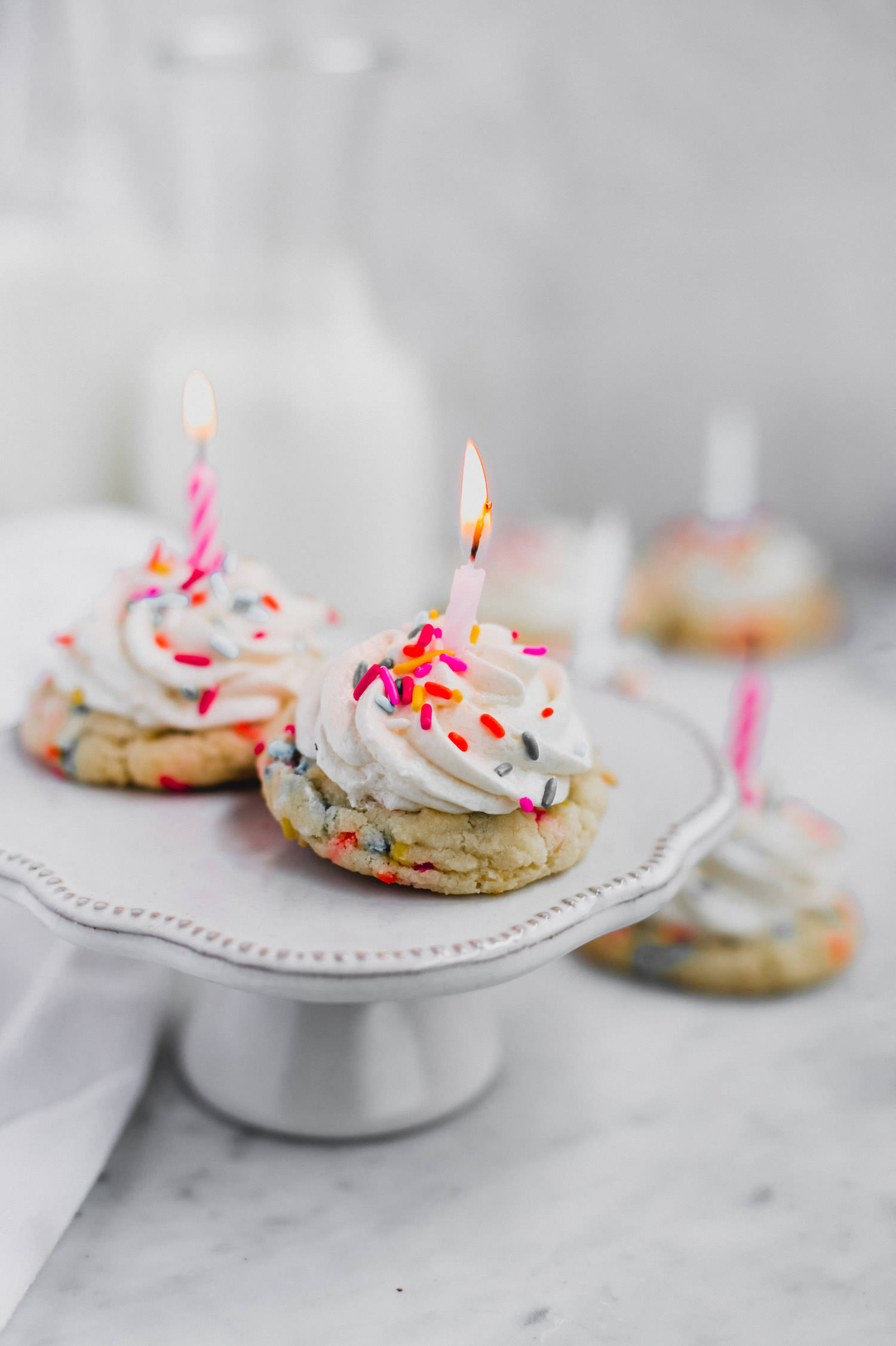 birthday cookies 10.jpgFunfetti Birthday Cookies: sot, chewy, rich, buttery sprinkle cookies topped with cream cheese frosting. Add a candle and you've got the ultimate birthday cookie! |TrufflesandTrends.com