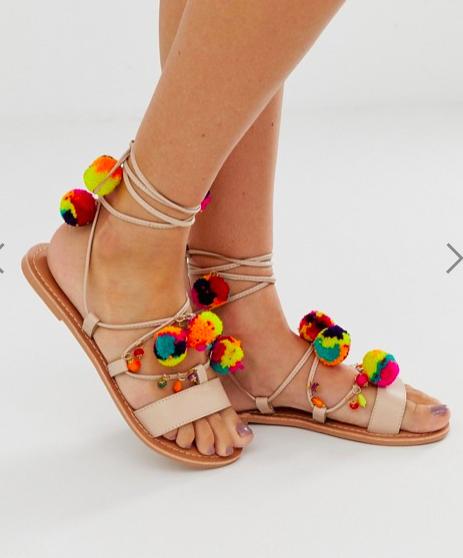 ASOS DESIGN Fun Fair pom pom leather tie leg flat sandals