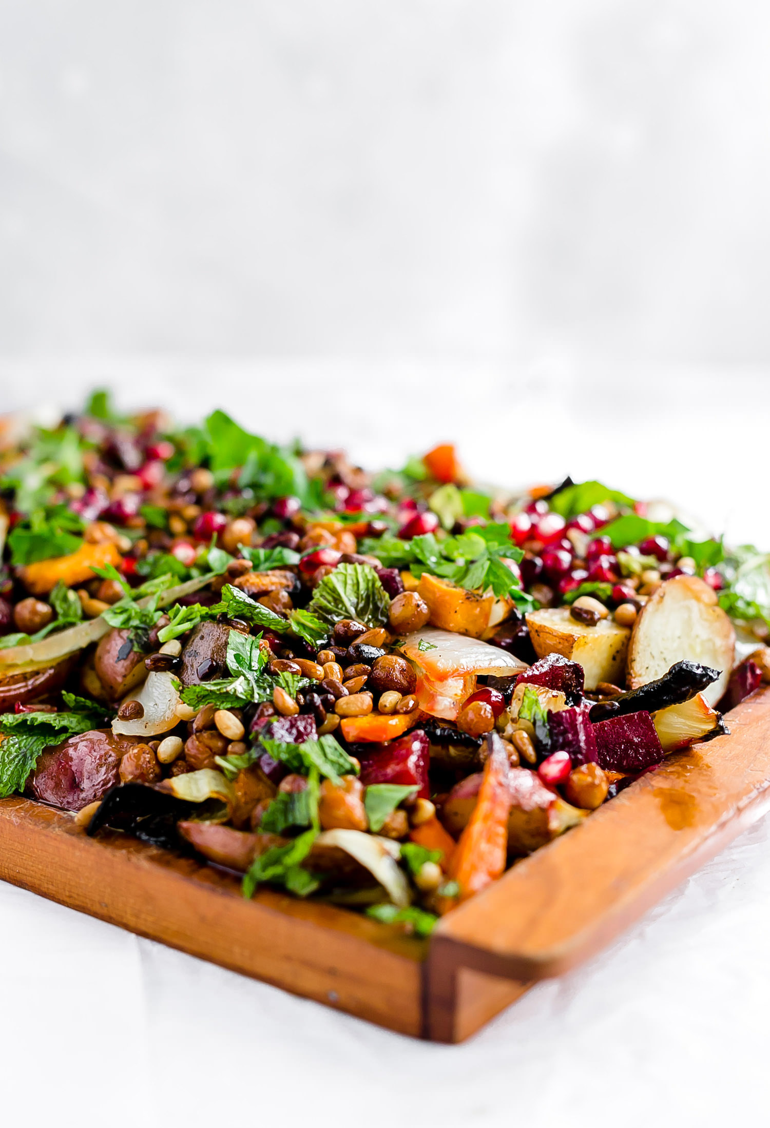 Roasted Vegetable Hummus Platter: hummus topped with tender roasted vegetables, crispy chickpeas, pomegranates, herbs, pine nuts, and a balsamic glaze. Best side dish! | TrufflesandTrends.com