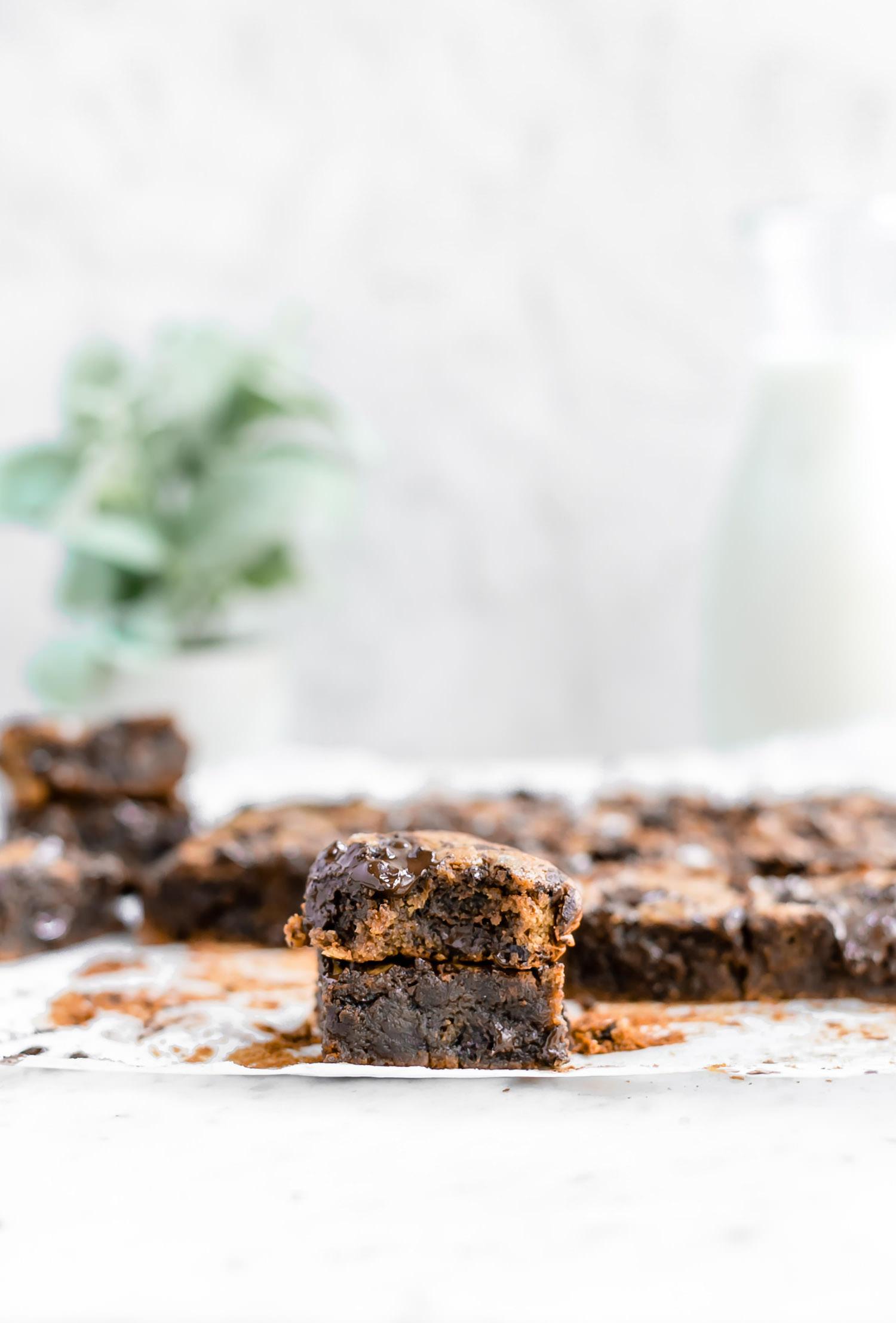 Wholesome Gluten-Free Tahini Chocolate Chip Blondies: rich, dense, gooey blondies made with tahini, coconut sugar, and chocolate chunks. Dairy and gluten free! | TrufflesandTrends.com