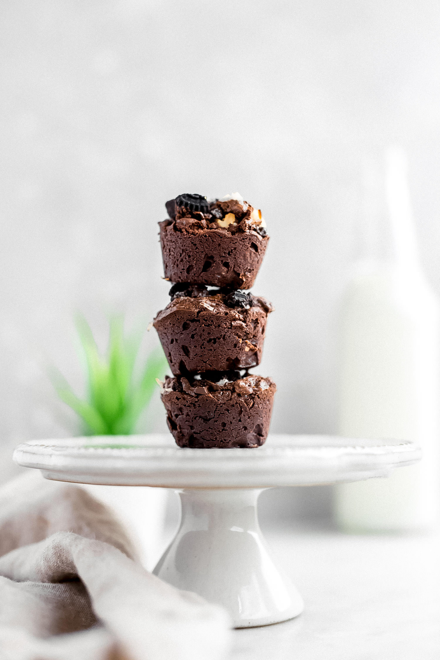One-Bowl Mini Everything Brownie Cups: thick, rich, gooey, fudgy brownie cups packed with chocolate chunks, Oreo cookies, shredded coconut, and walnuts. | TrufflesandTrends.com