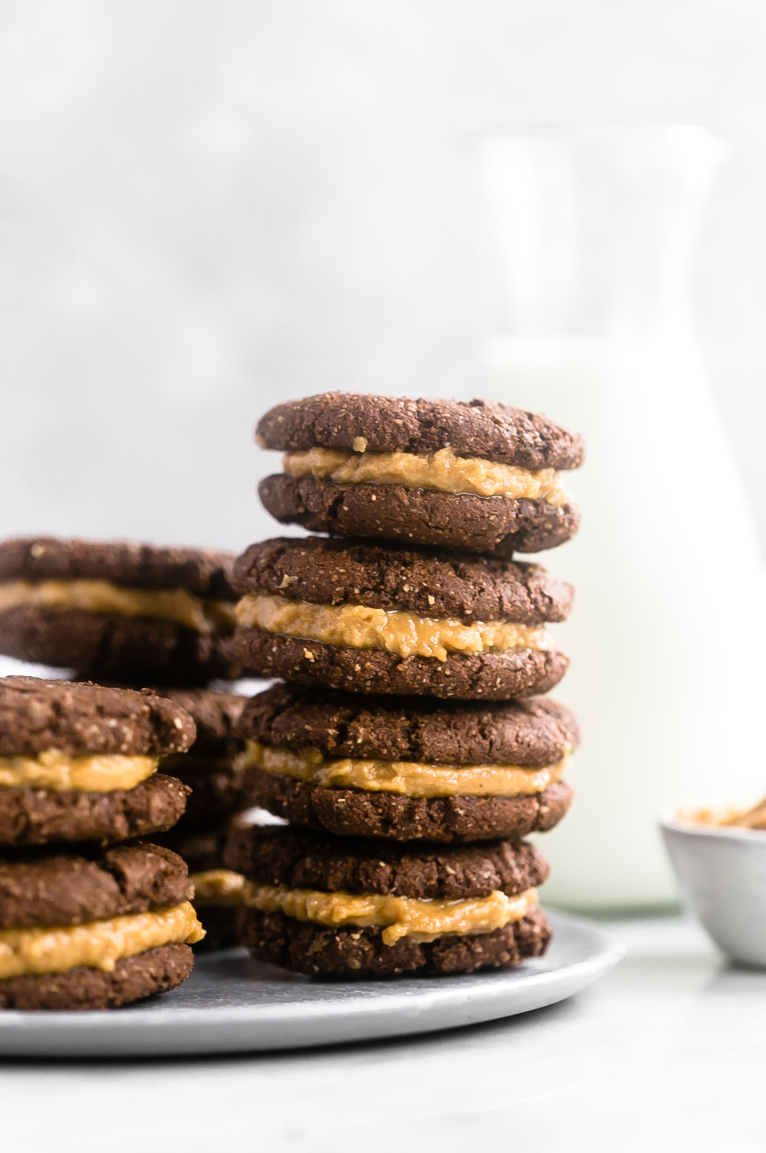 Gluten-Free Chocolate Peanut Butter Sandwich Cookies: rich, chewy, tender chocolate cookies filled with a creamy peanut butter filling. Dairy and gluten free! | TrufflesandTrends.com
