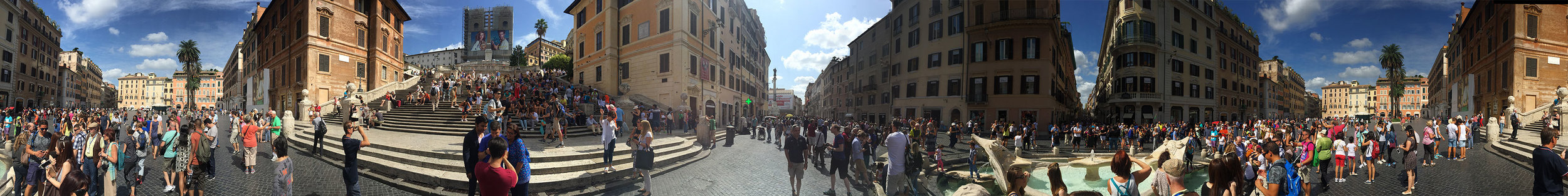 Panoramic photo of Piazza de Spagna at the foot of the Spanish Steps.