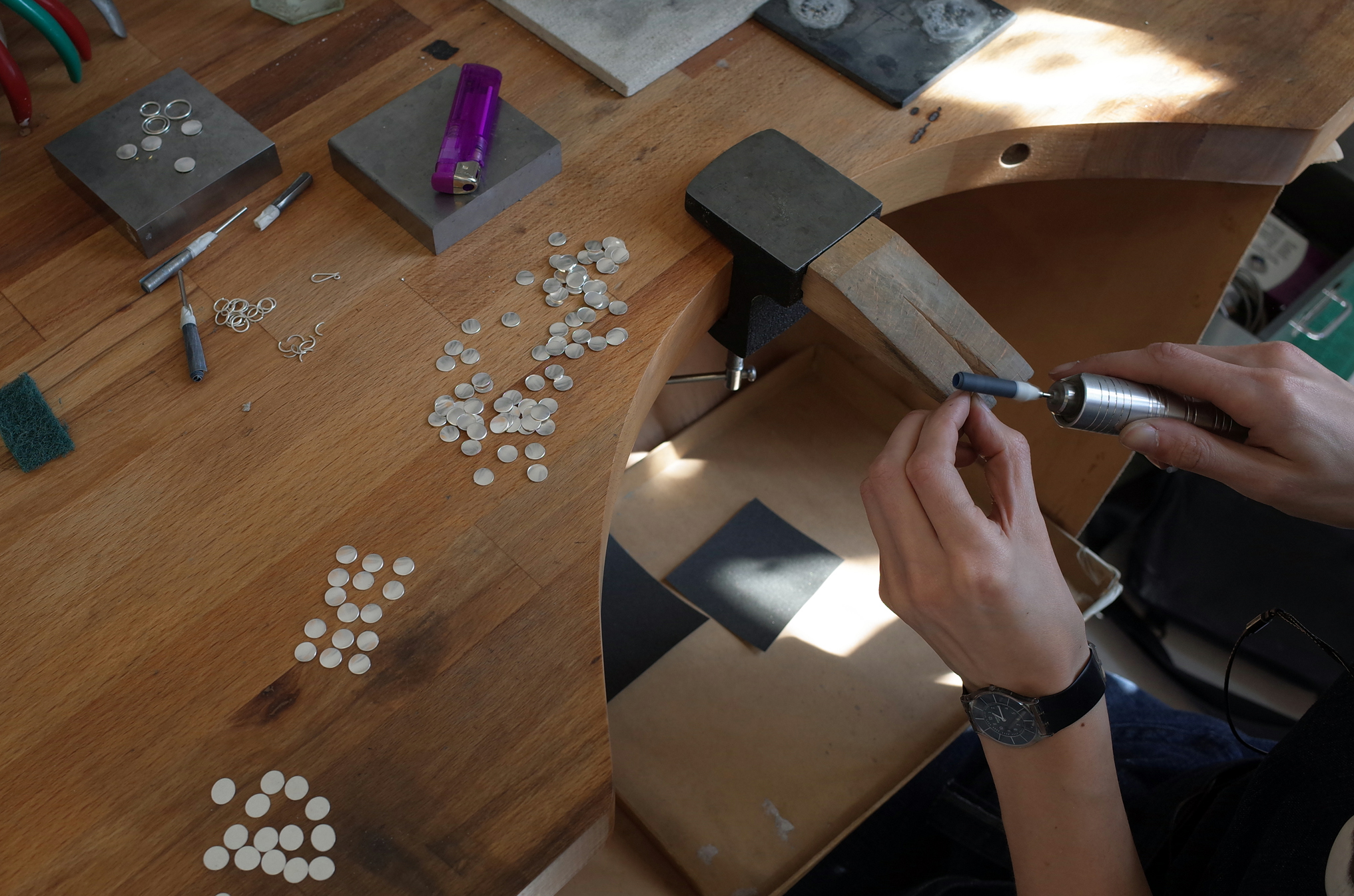 deburring and polishing the edges of each and every component