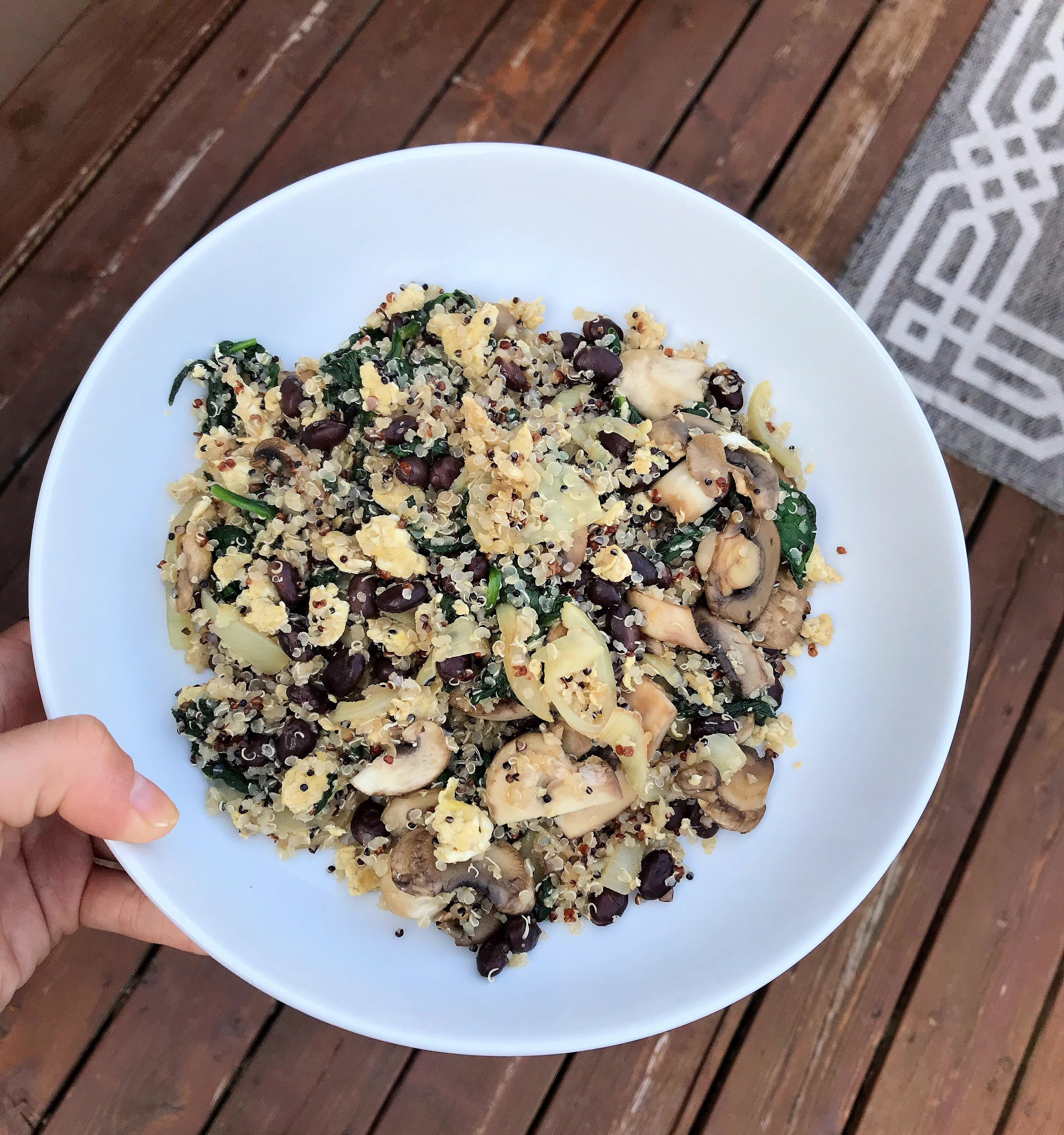 Quinoa Power Bowl - Rainbow quinoa + onions + spinach + egg + mushrooms + black beans + tamari soy sauceSauté onions and mushrooms in a medium sized pan. When lions become transparent move to the side of the pan and mix in 1-2 eggs. When the eggs are scrambled combine them with the mushrooms and onions. Add in spinach, black beans, quinoa, and seasoning with tamari soy sauce!