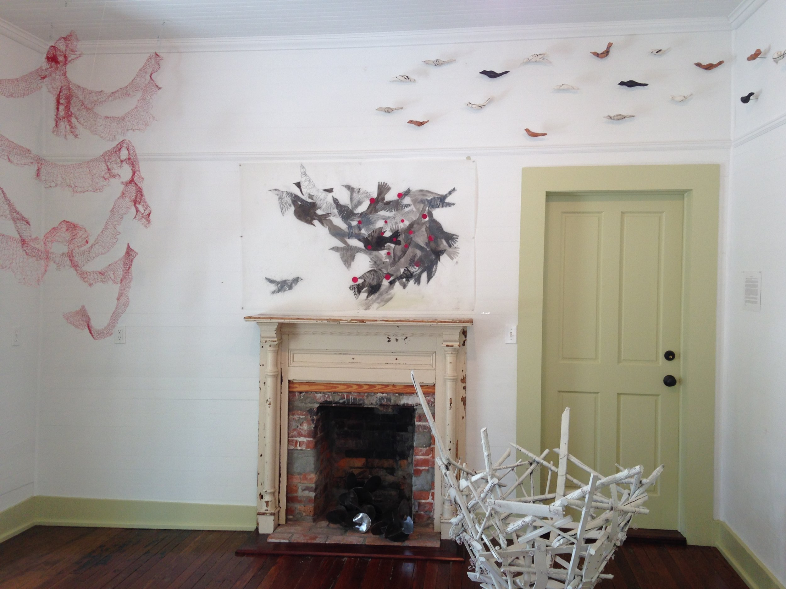 Installation of Birds in Flock with graphite drawings.