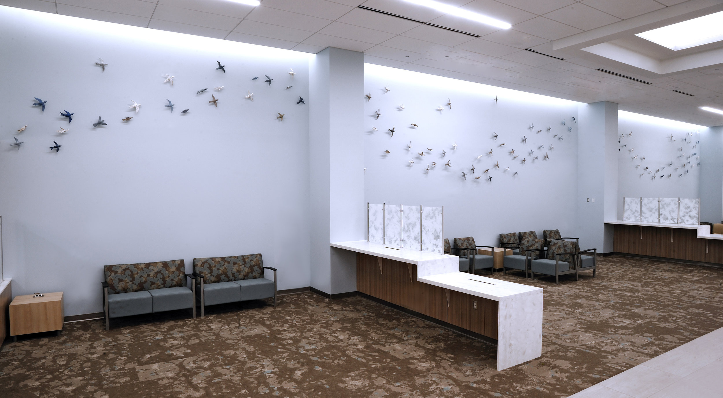 Murmuration , 10'x74', multiple clay birds across 3 walls. Photo by Gregory Staley.