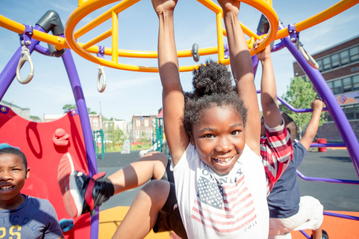 William Dick School students enjoy new play equipment.