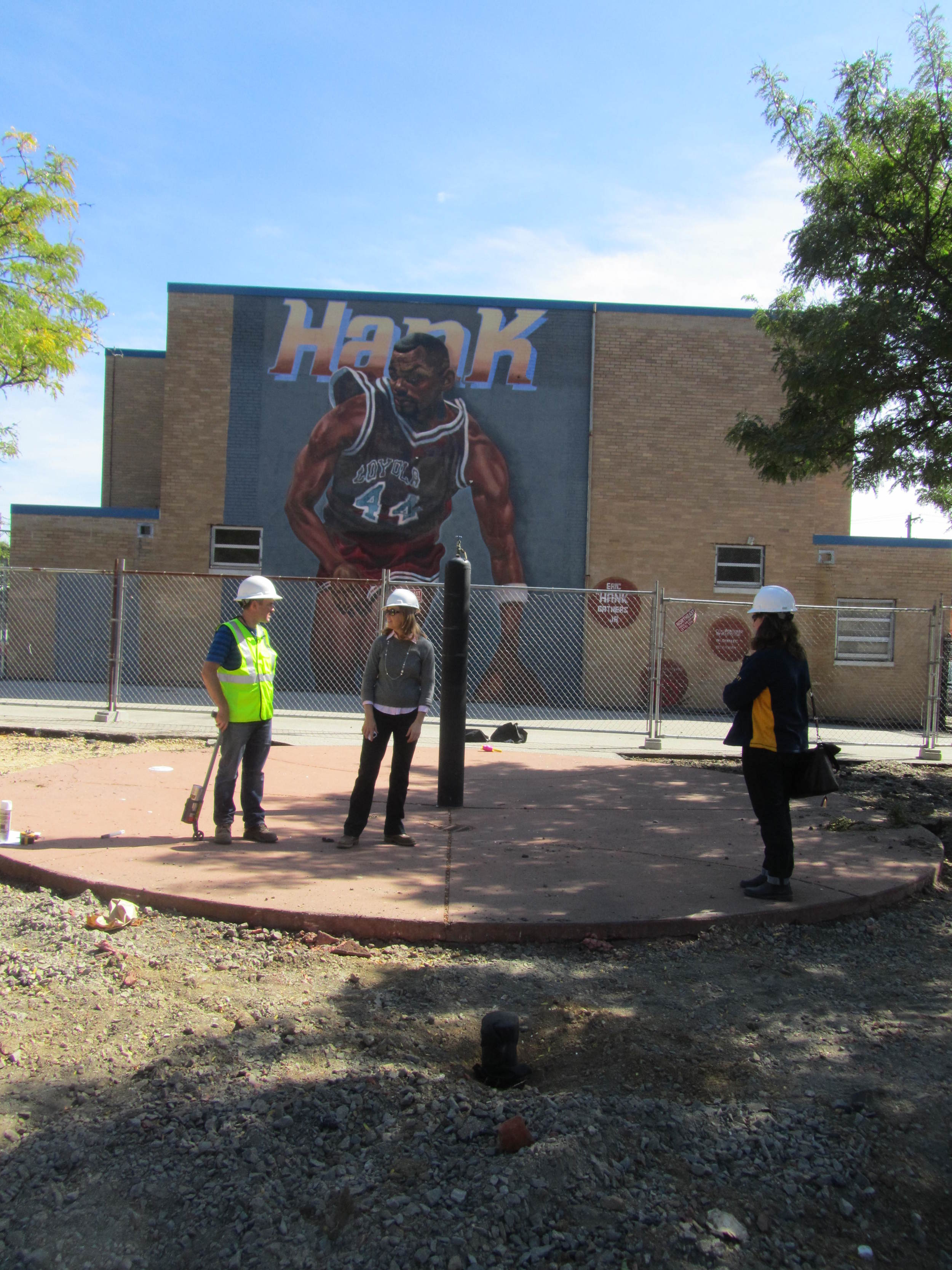 Project team members gather near new spray ground.