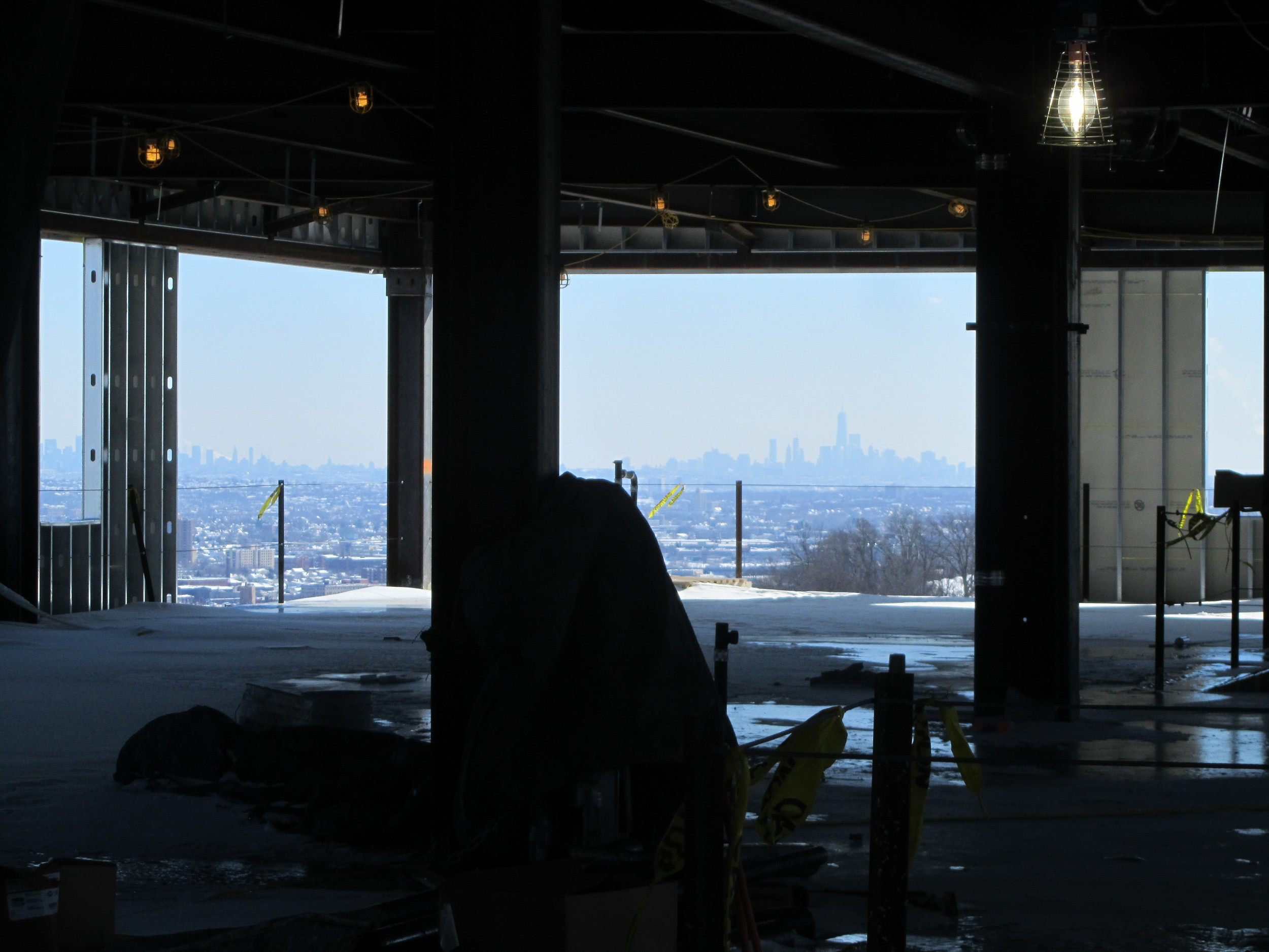 View of NYC skyline from top floor of New Academic Building