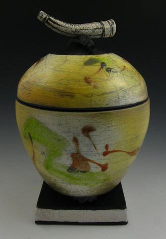 Celestial Orb Raku-stye companion urn is large enough to hold the cremated remains of two people. Costs $469 at the marvelous website Artisurns.com, where other handmade pieces for two can be commissioned.