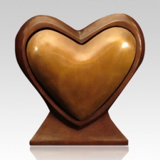 """The ultimate valentine: a """"Loving Heart"""" companion bronze urn with two compartments for cremated remains, $2,374 on Memorials.com."""