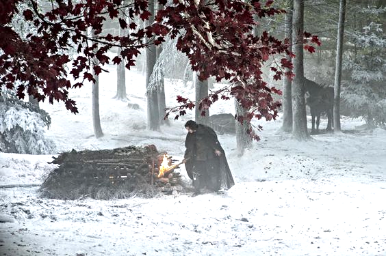 Service for one: With tears in his eyes, a dutiful and beleaguered Jon Snow lights his lover Ygritte's pyre.