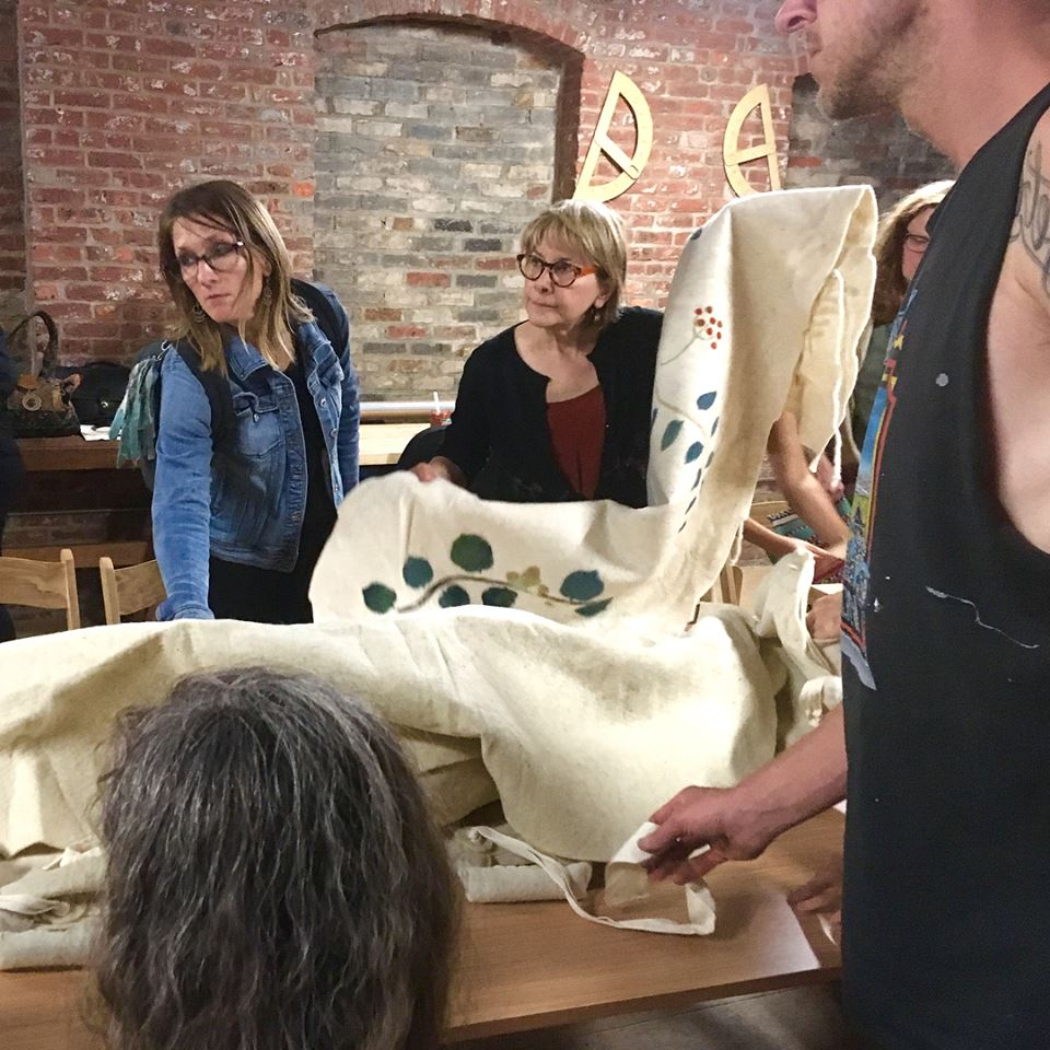 Amy shows a felted wool shroud from Bellacouche.com at her greener funeral talk, Pioneer Works, Brooklyn, October 4, 2017.