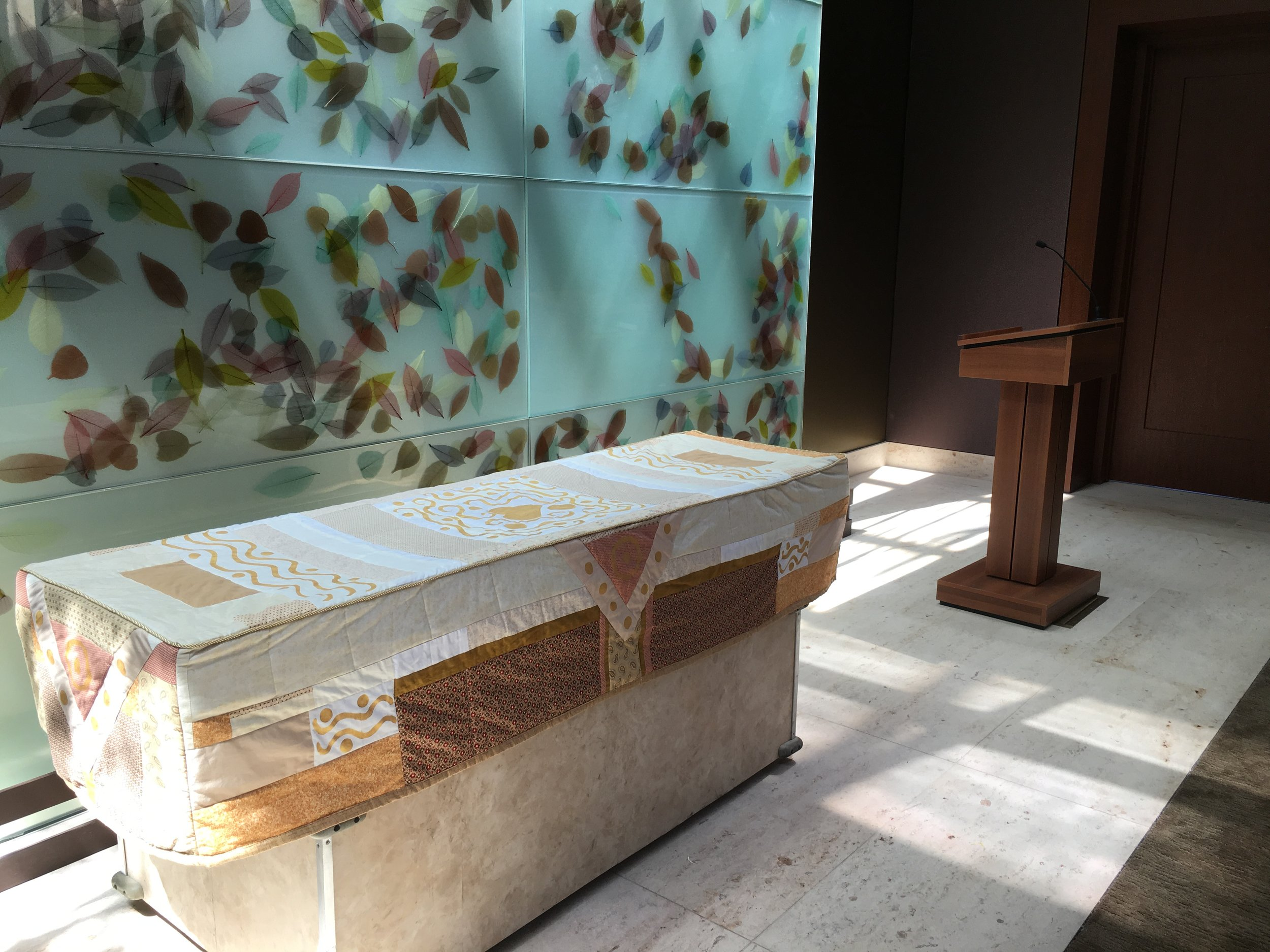 A simple cardboard casket can look like a million bucks with our pretty quilted cover made by Park Slope artist Louise Guerin. We'll help you think out the flowers that can go on top.