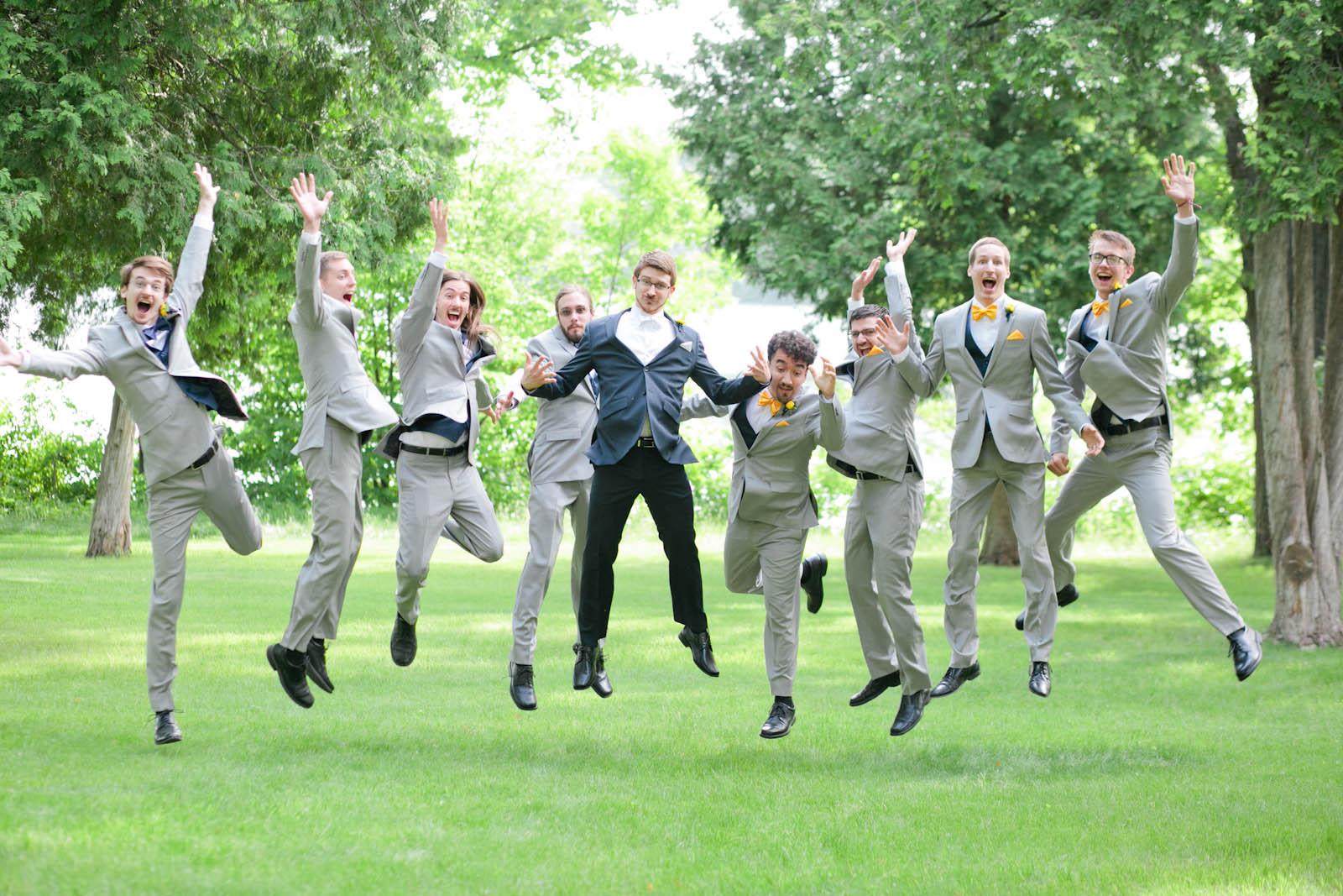 fun groomsmen jumping wedding photo