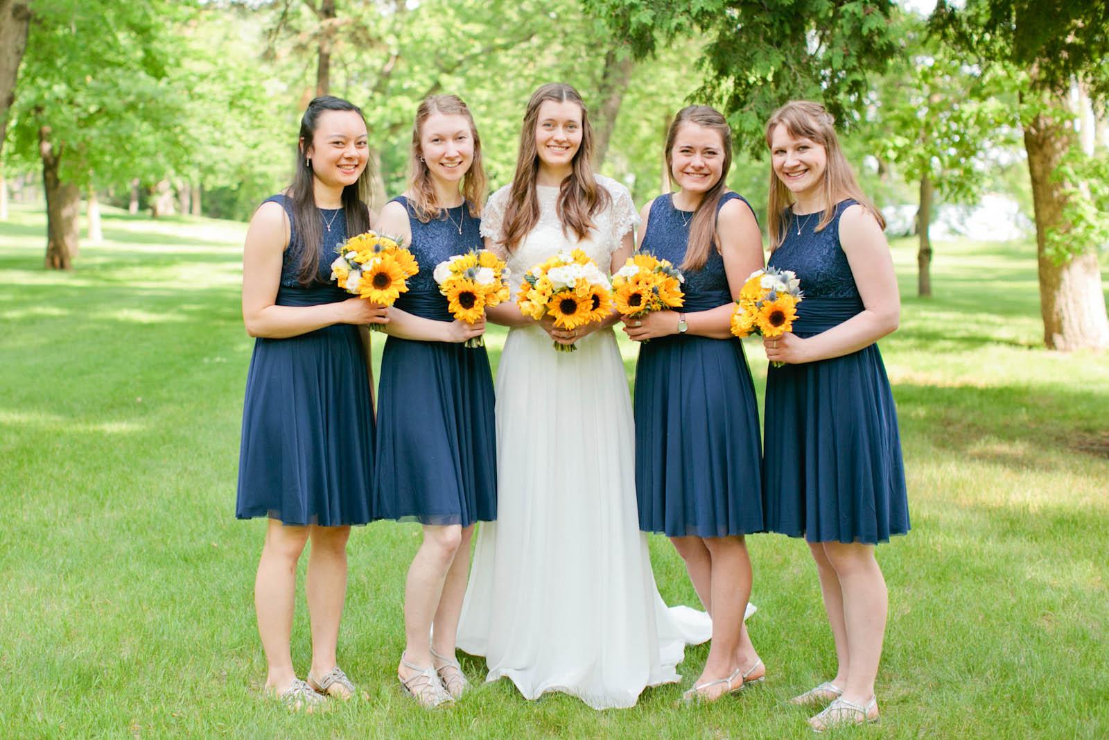 bride and bridesmaids outdoor minnesota wedding photographer