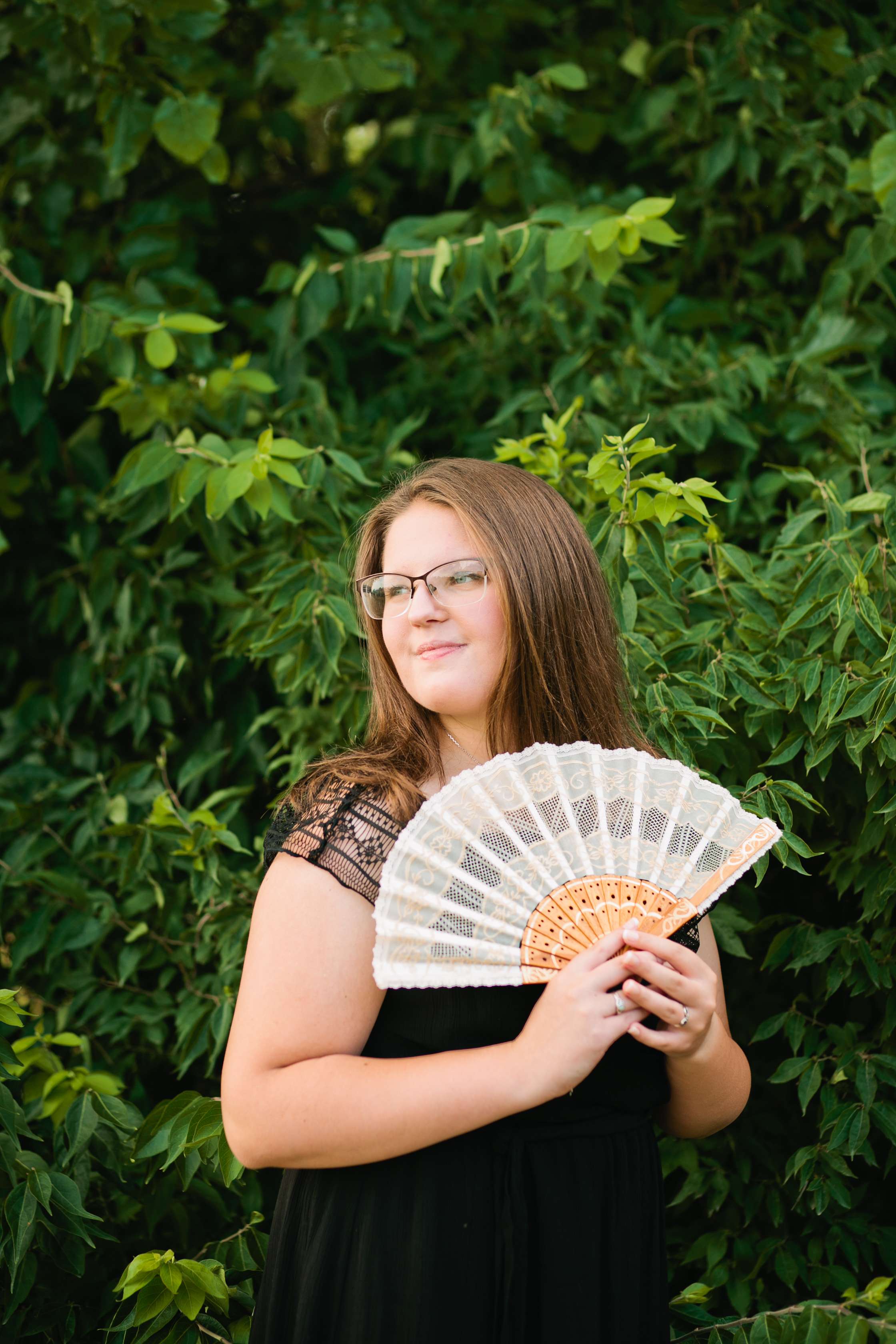girl with japanese fan in formal dress