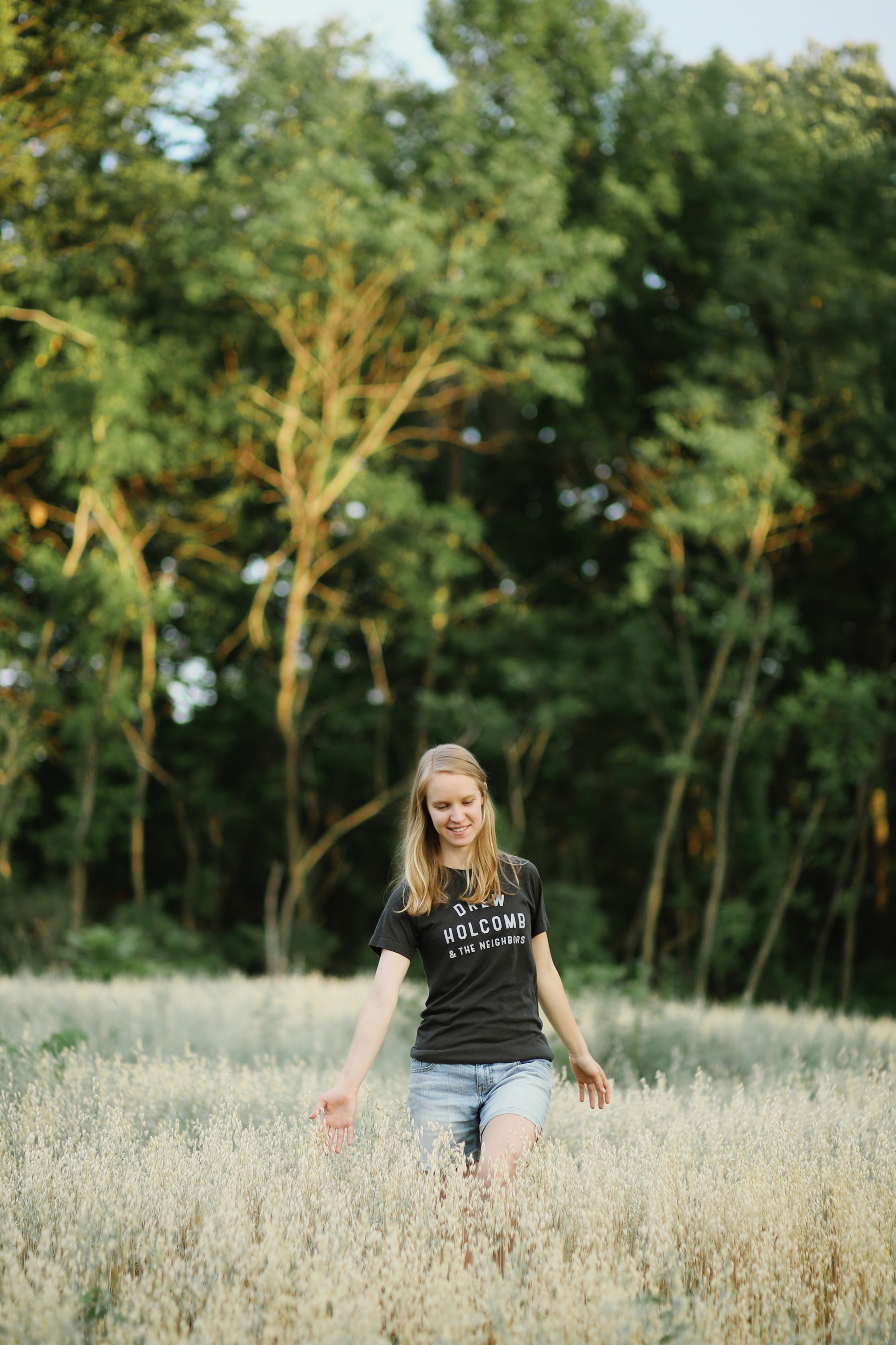 girl walking through wheat fields