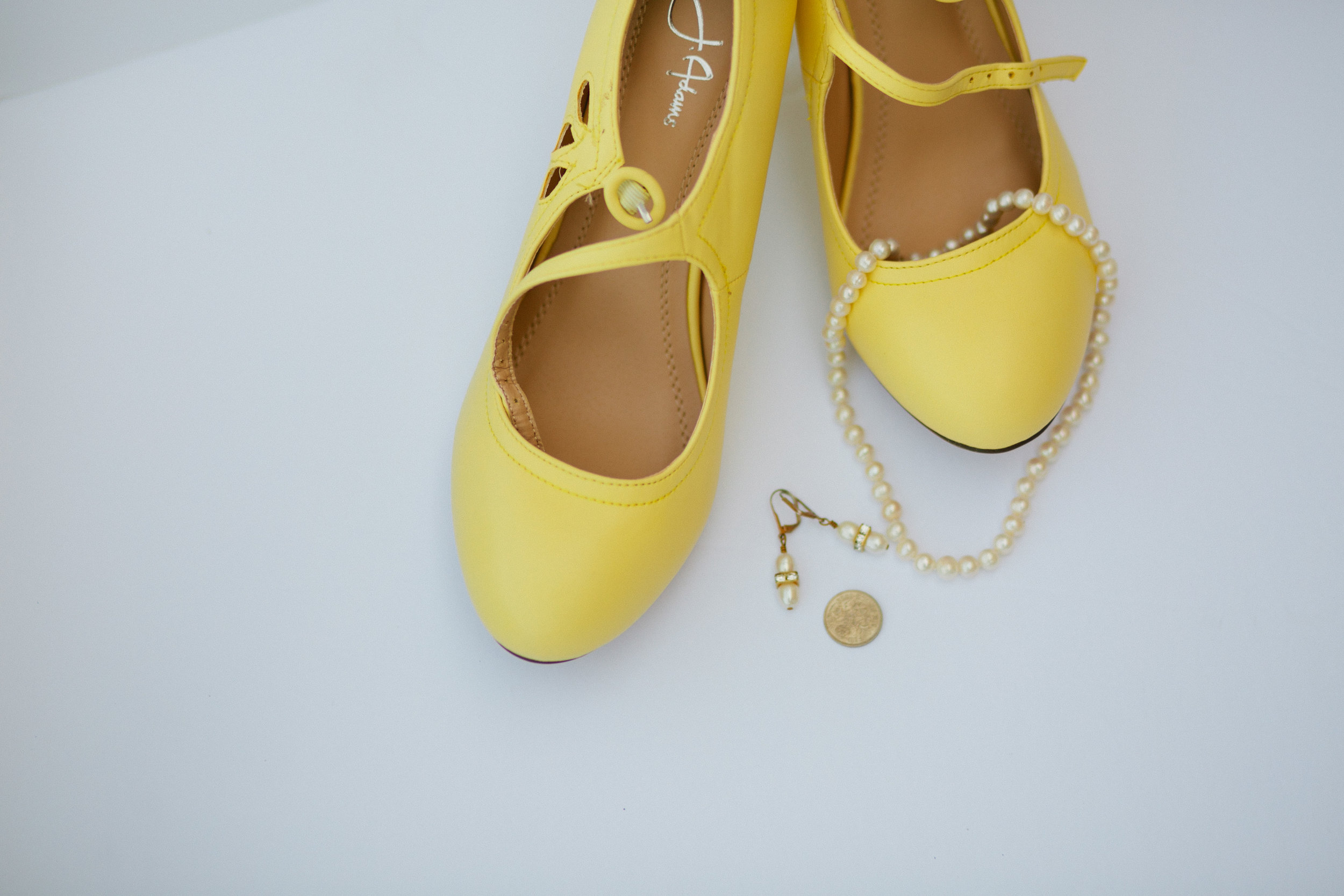 yellow soes and a sixpence wedding jewelry