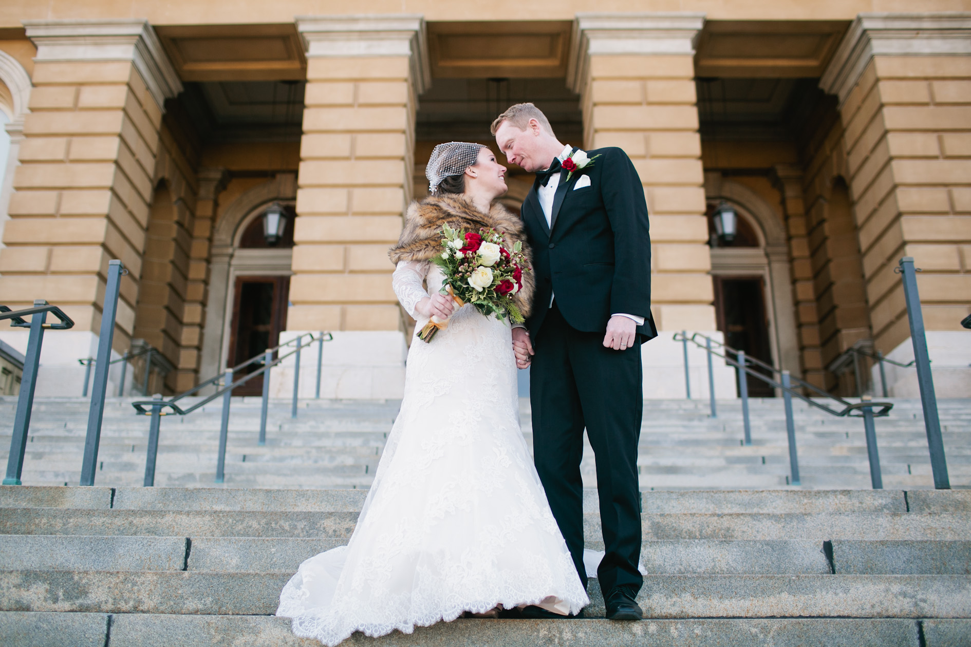 wedding photos at the Iowa State Capital building winter wedding