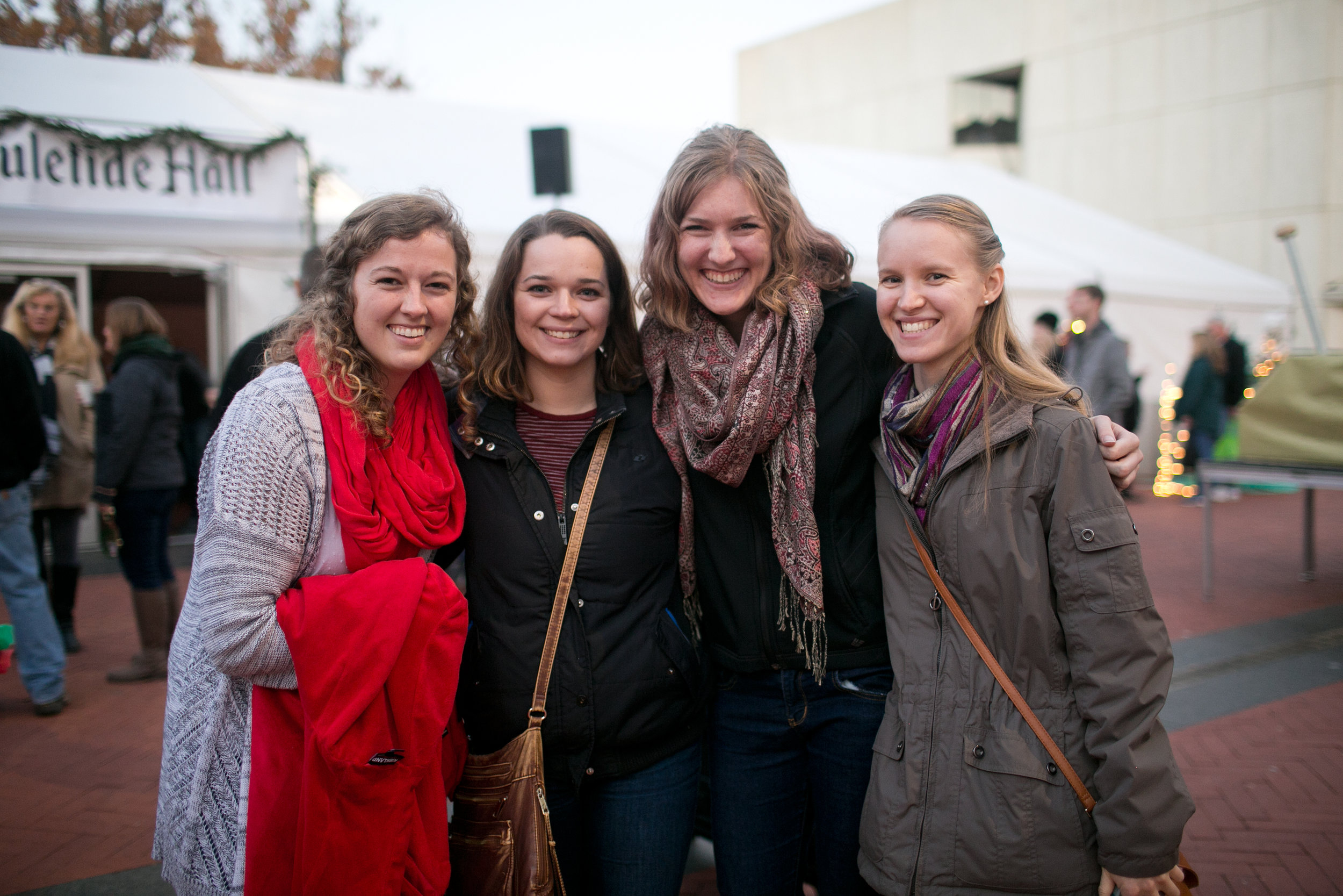 Four Iowa State University students visit Cowles Commons during the Des Moines Christkindlmarket in December.