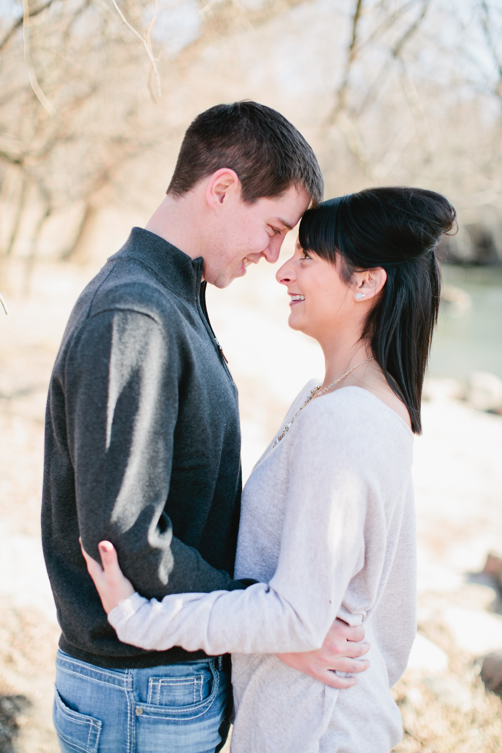 engagement photos in winter by a river in Iowa