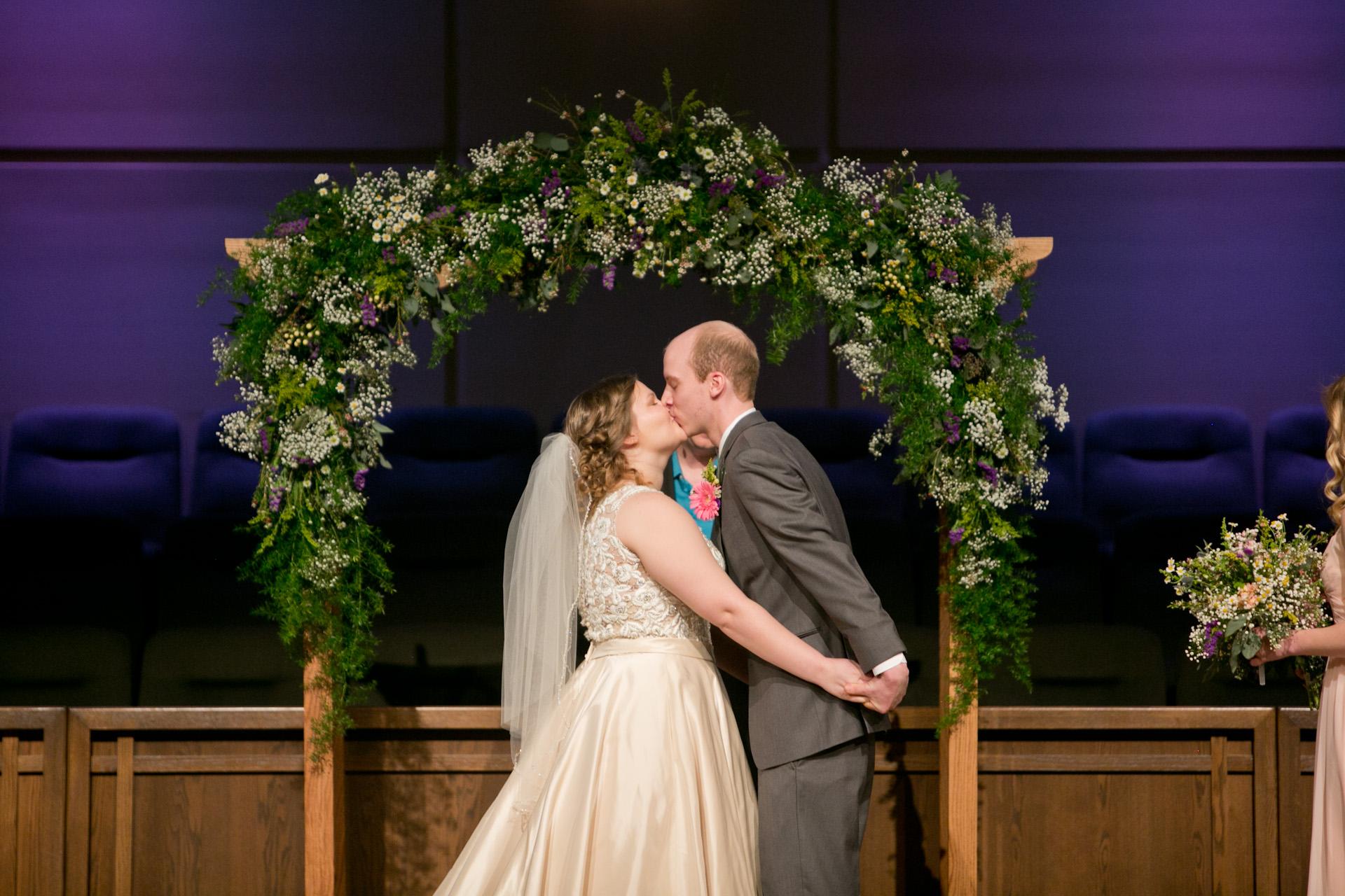 first kiss wedding photos