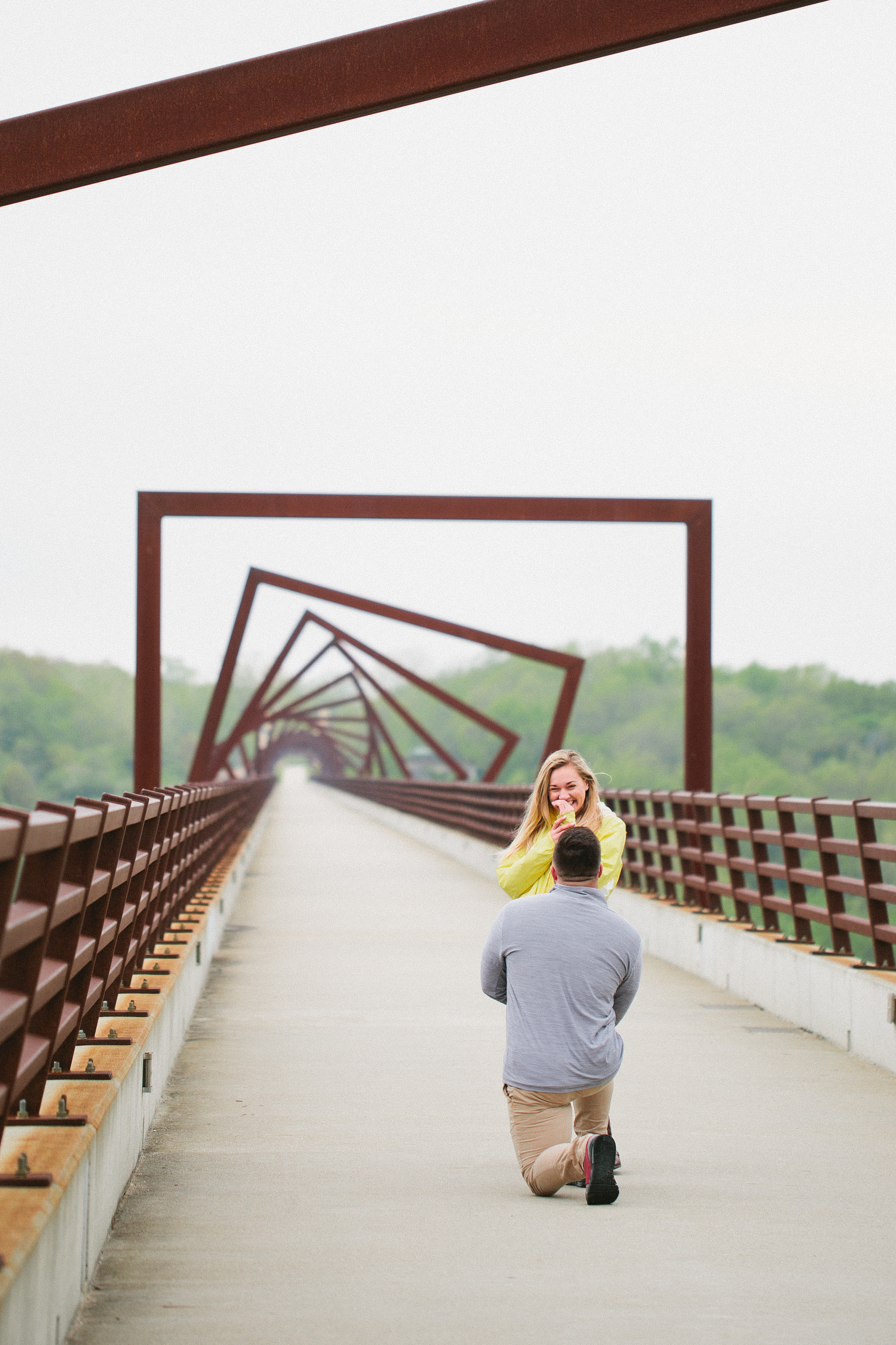a spring marriage proposal at the high trestle trail bridge