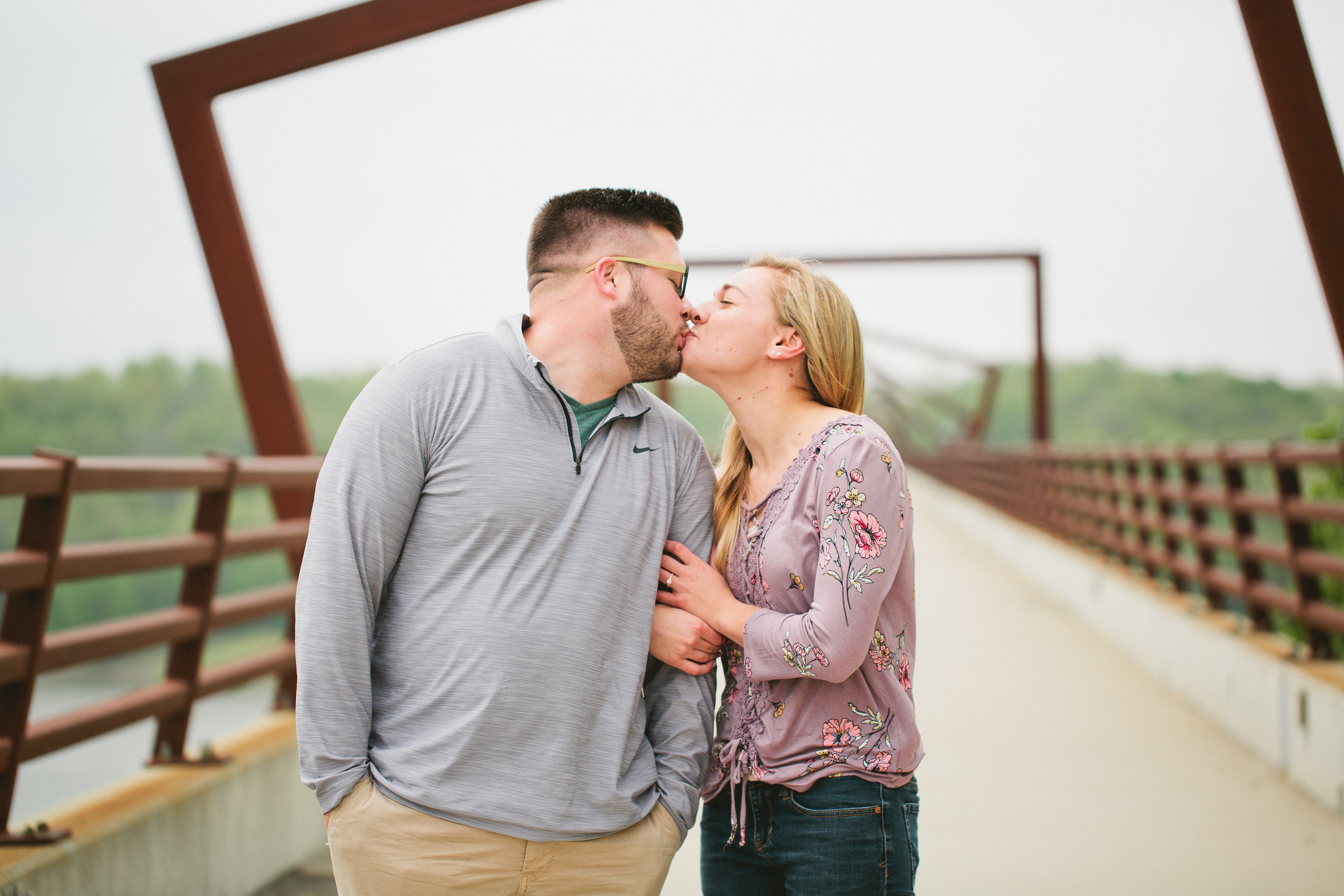 Julia was pretty over the moon excited! She didn't stop beaming after Rich proposed to her on the high trestle trail bridge in May!