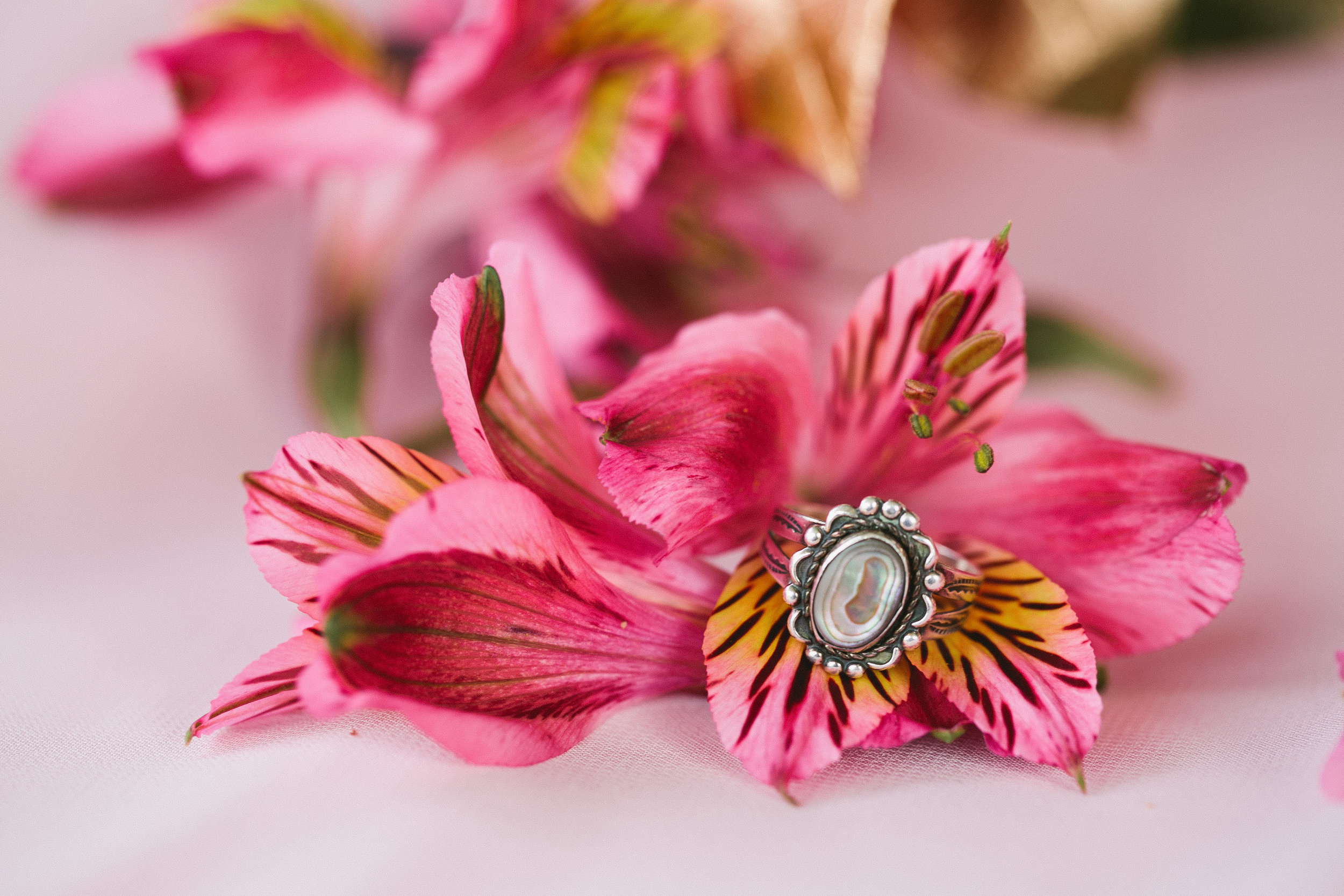 pink flowers and opal wedding ring