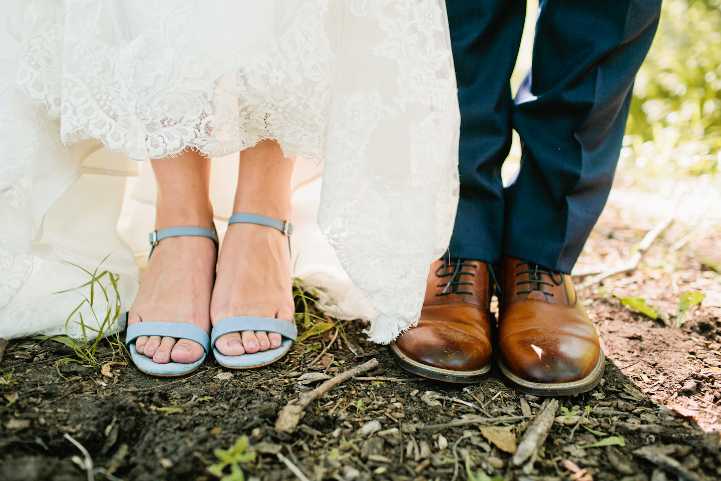 groom wearing brown shoes and bride wearing blue suede heels