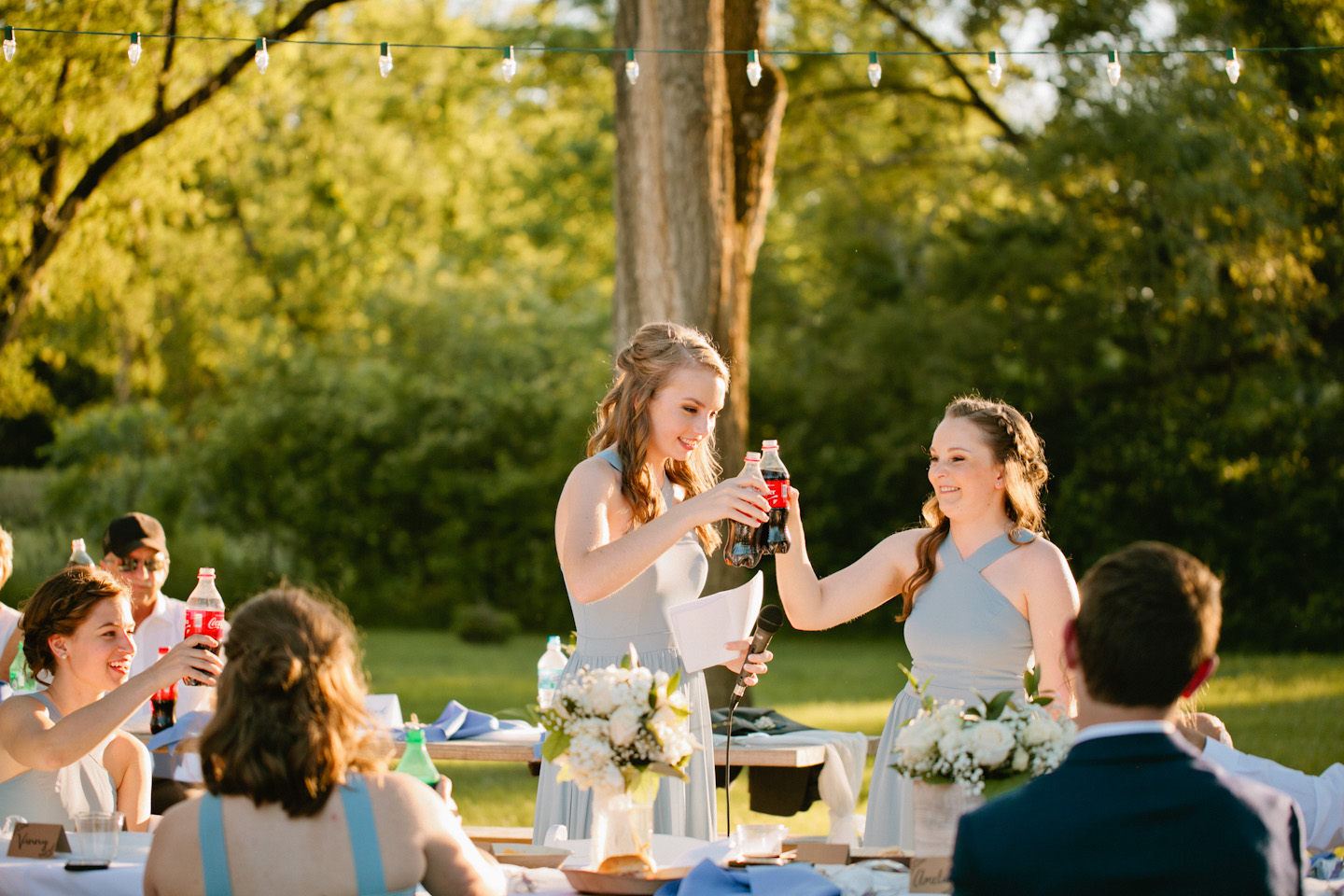 sunset wedding reception by lake in Iowa