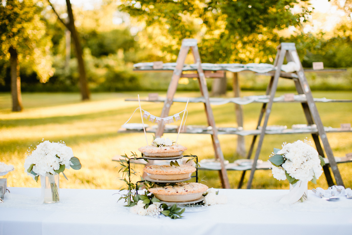 gorgeous pie stand at outdoor wedding reception in summer