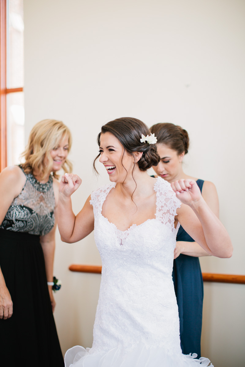 bride excited to put on her wedding dress