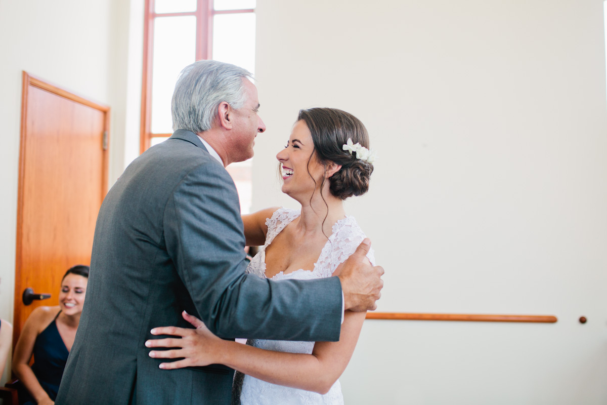 bride and dad having a first look moment