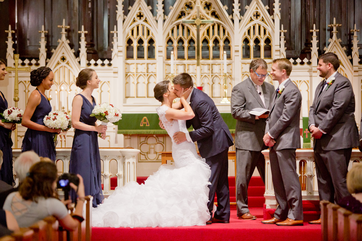 first kiss in magnificant dress and church