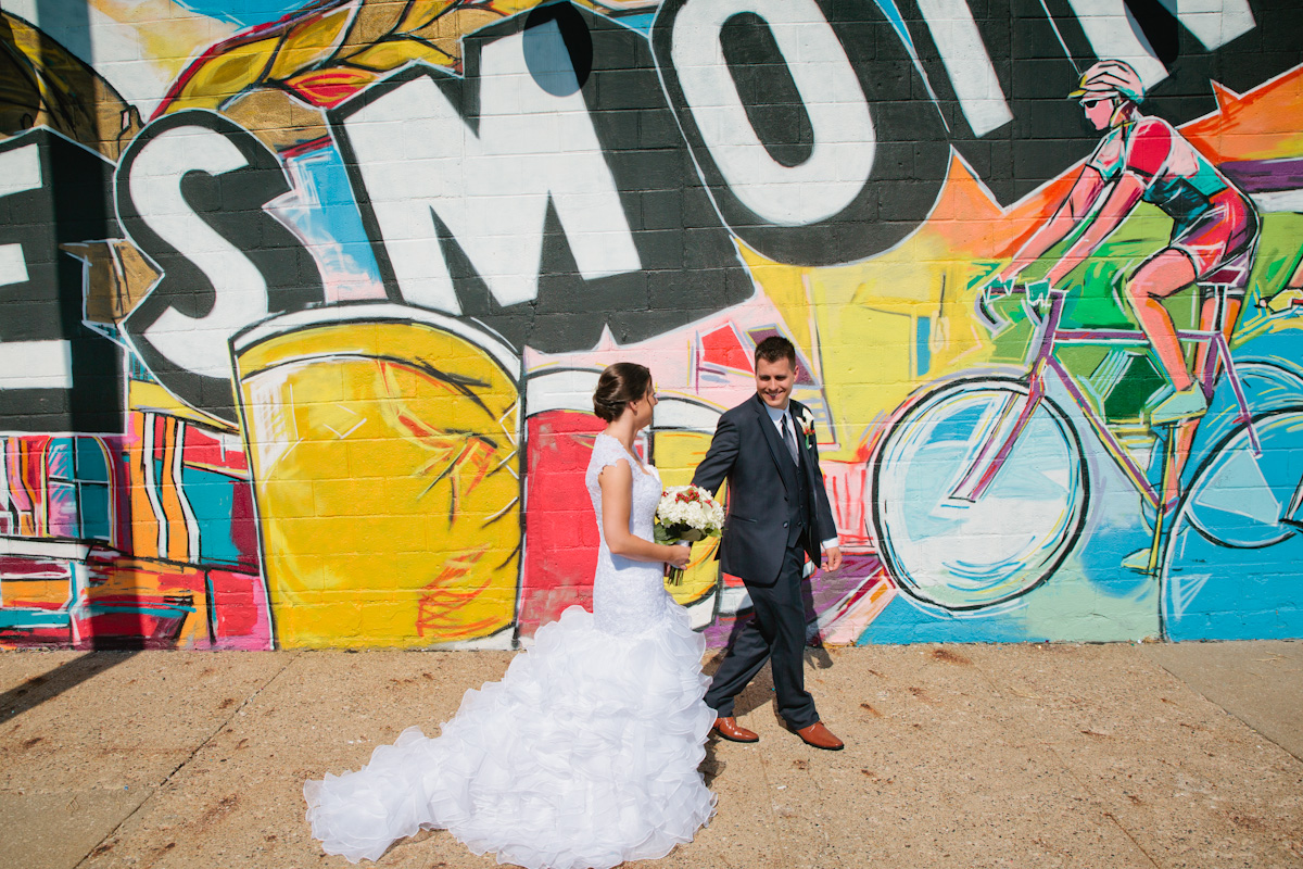 wedding photos outside Exile Brewery mural