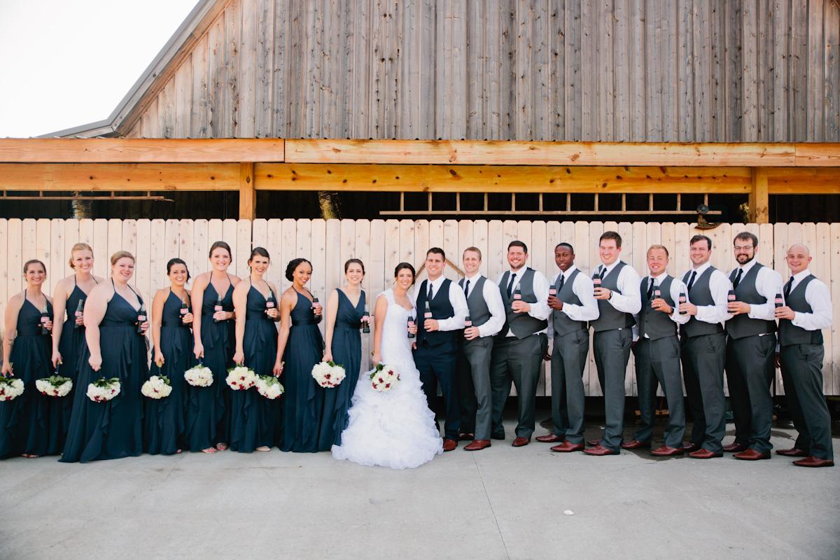 photo of large bridal party outside barn wedding venue